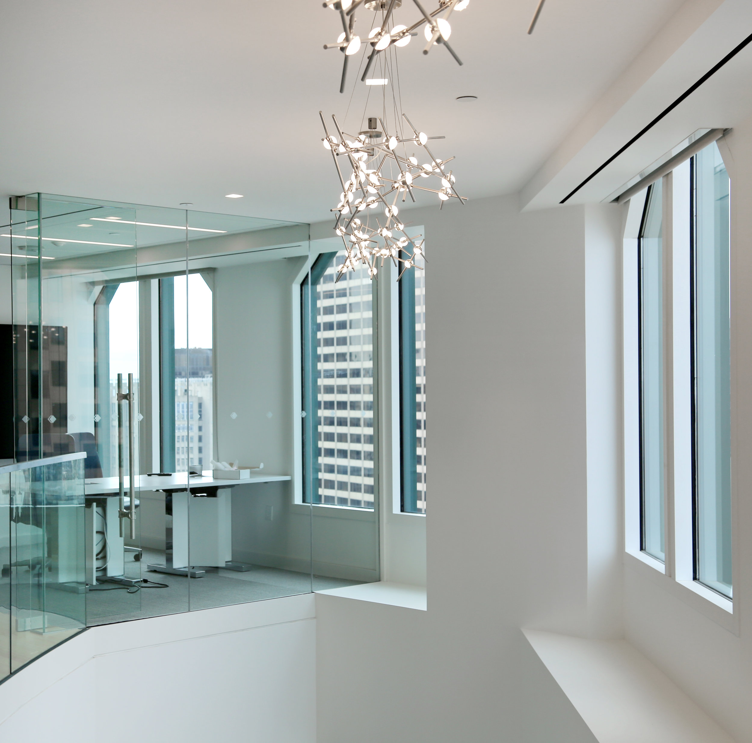 Frameless Glass Floating Wall System Above Stair - Spaceworks AI.jpg