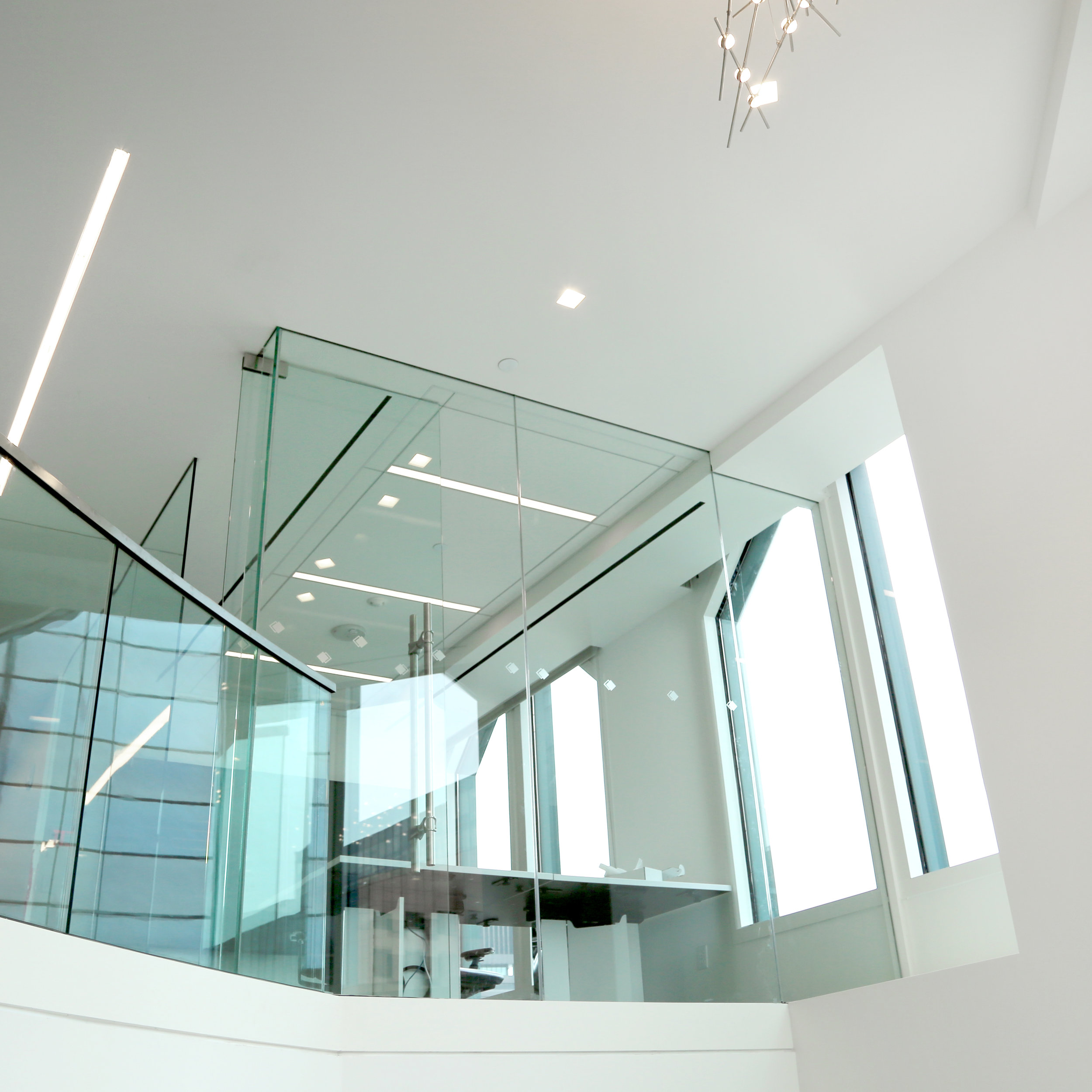Frameless Glass Office Wall Over Open Stair - Spaceworks AI.jpg