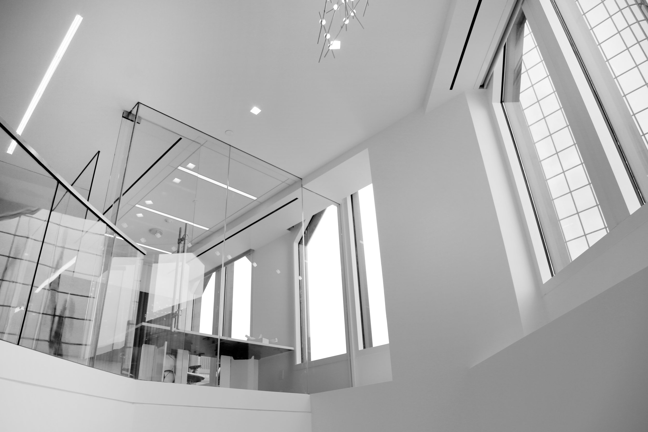 Frameless Glass Office Wall System View from Below - Spaceworks AI.jpg