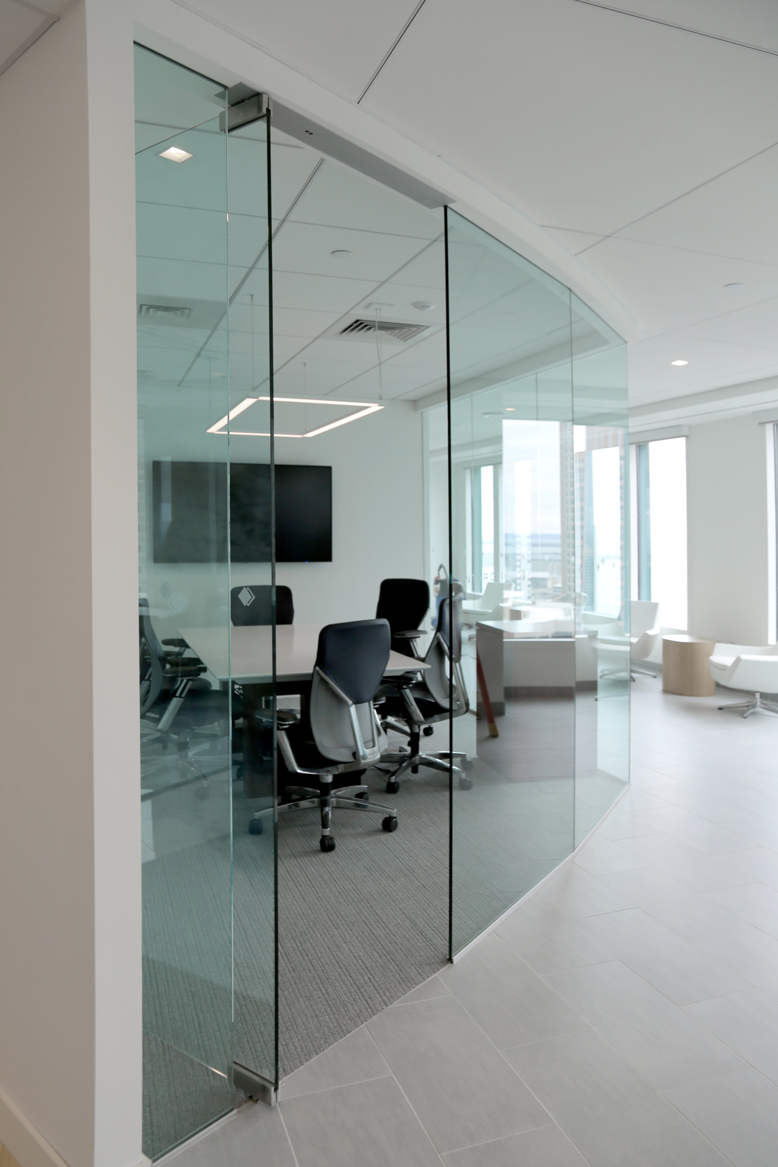 Frameless Glass Patch Fitting Pivot Door System - Spaceworks AI.jpg