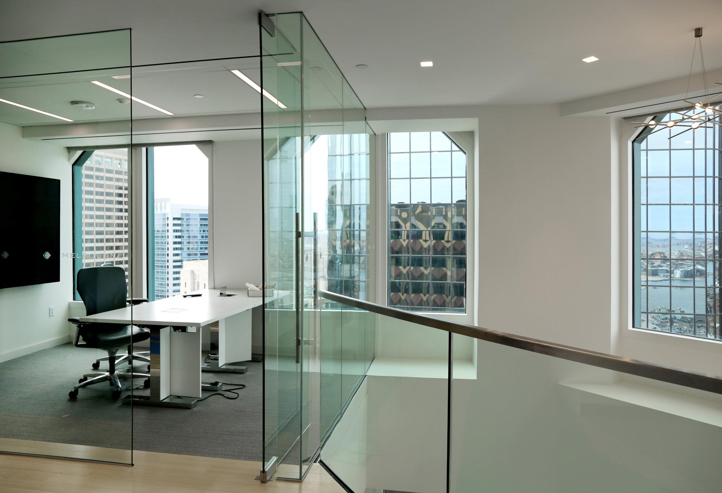 Frameless Glass Pivot Swing Door in Frameless Glass Wall Front - Spaceworks AI.jpg