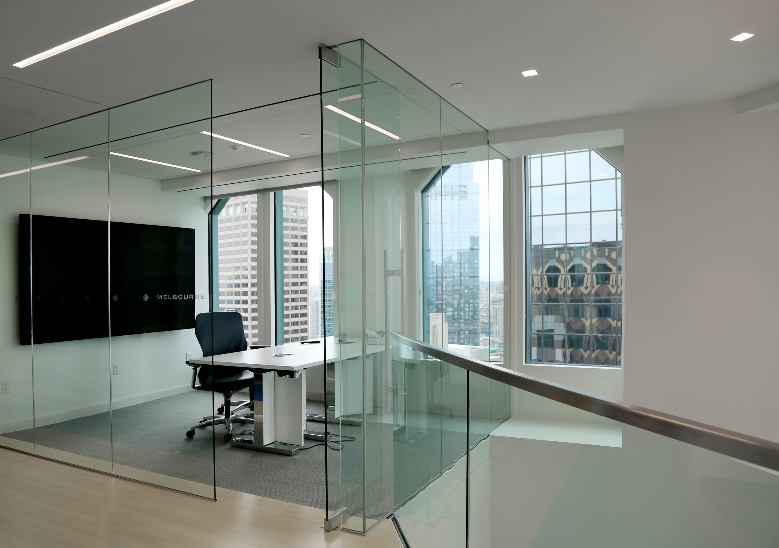 Frameless Glass Wall and Stair Corner Condition Metal Railing - Spaceworks AI.jpg