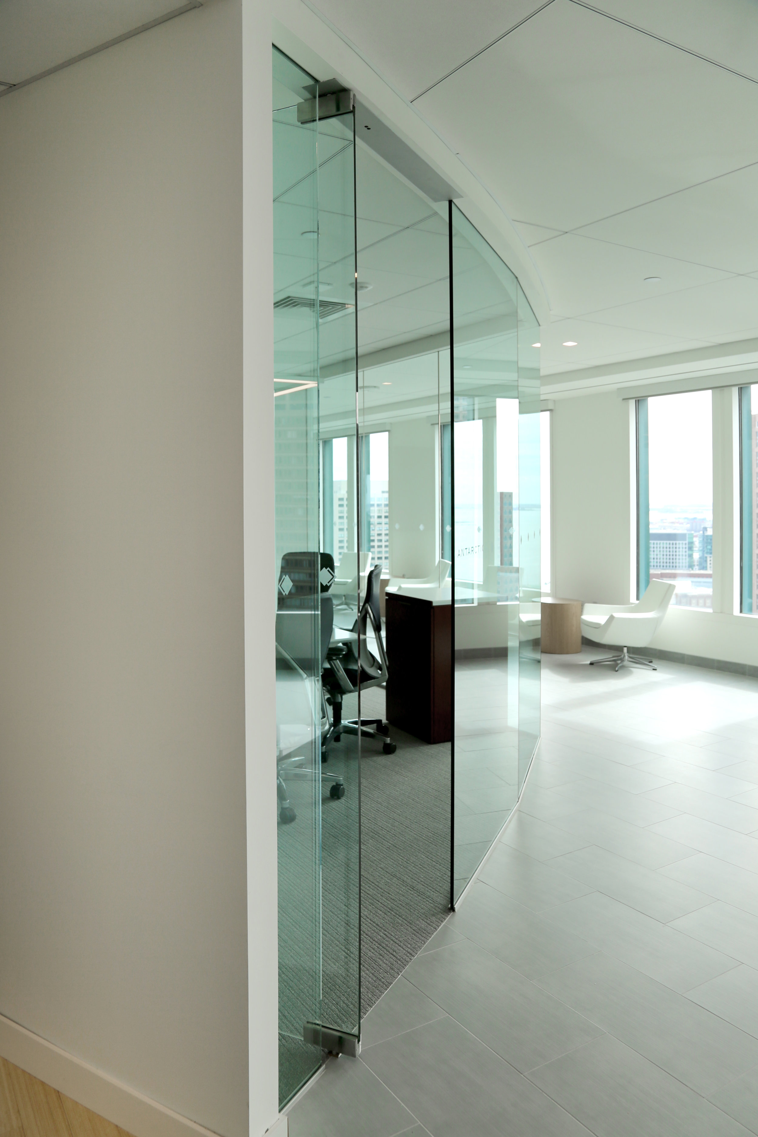 Framless Glass Faceted Wall System Butt-Glazed  - Spaceworks AI.jpg