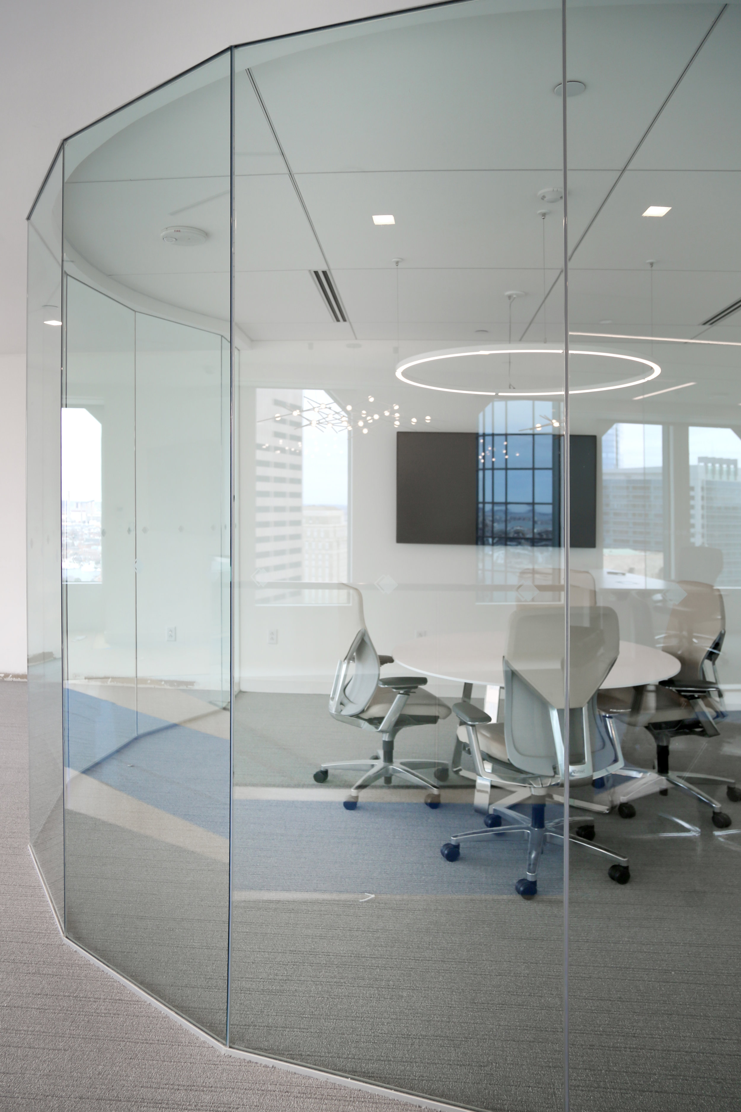 Illume Frameless Glass Curved Stick-Built Faceted Wall System - Spaceworks AI.jpg