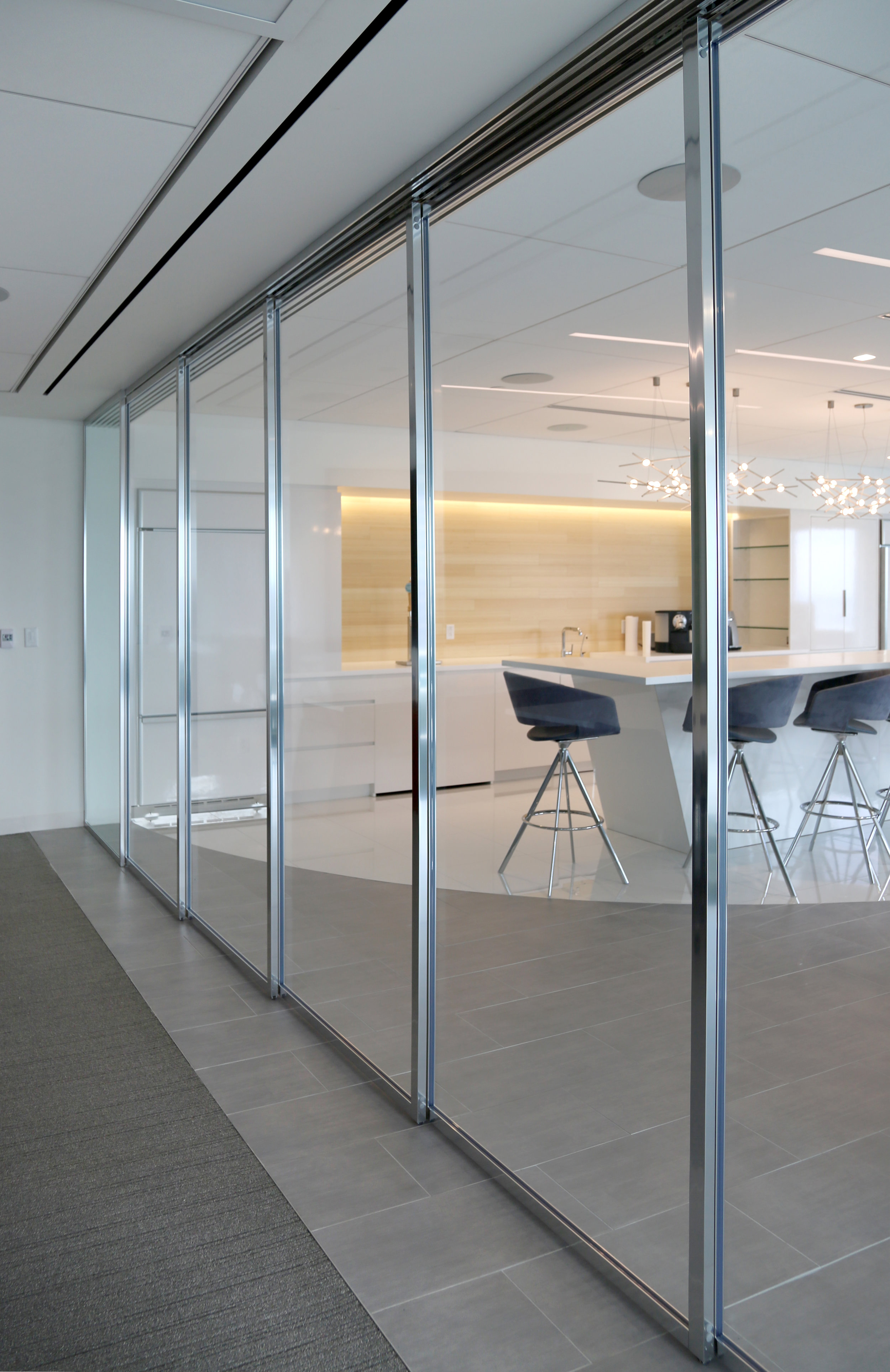 Modernus Glass Wall System with Sliding Panels - Spaceworks AI.jpg