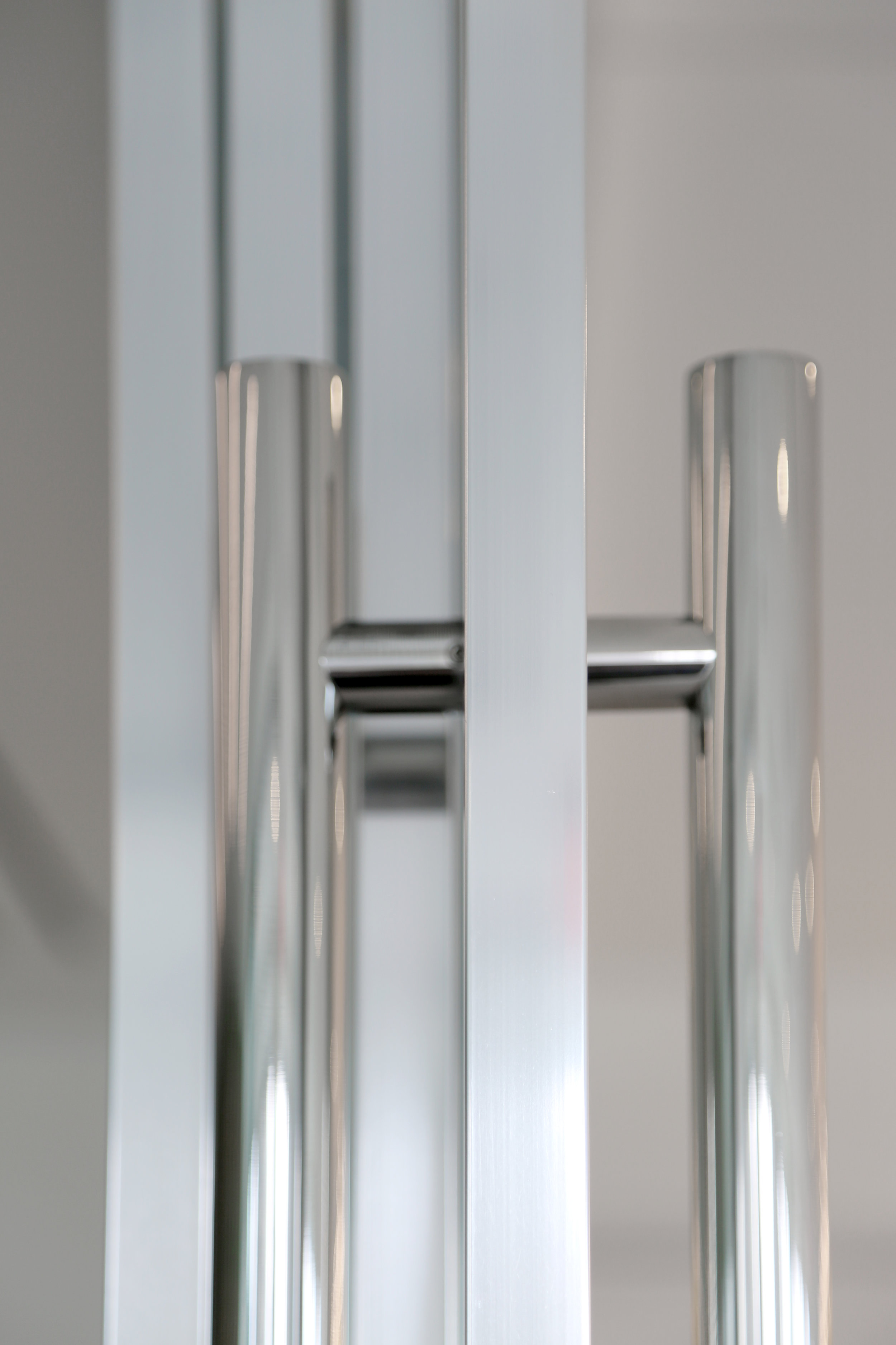 Polished Metal Ladder Pulls Glass Panel System - Spaceworks AI.jpg