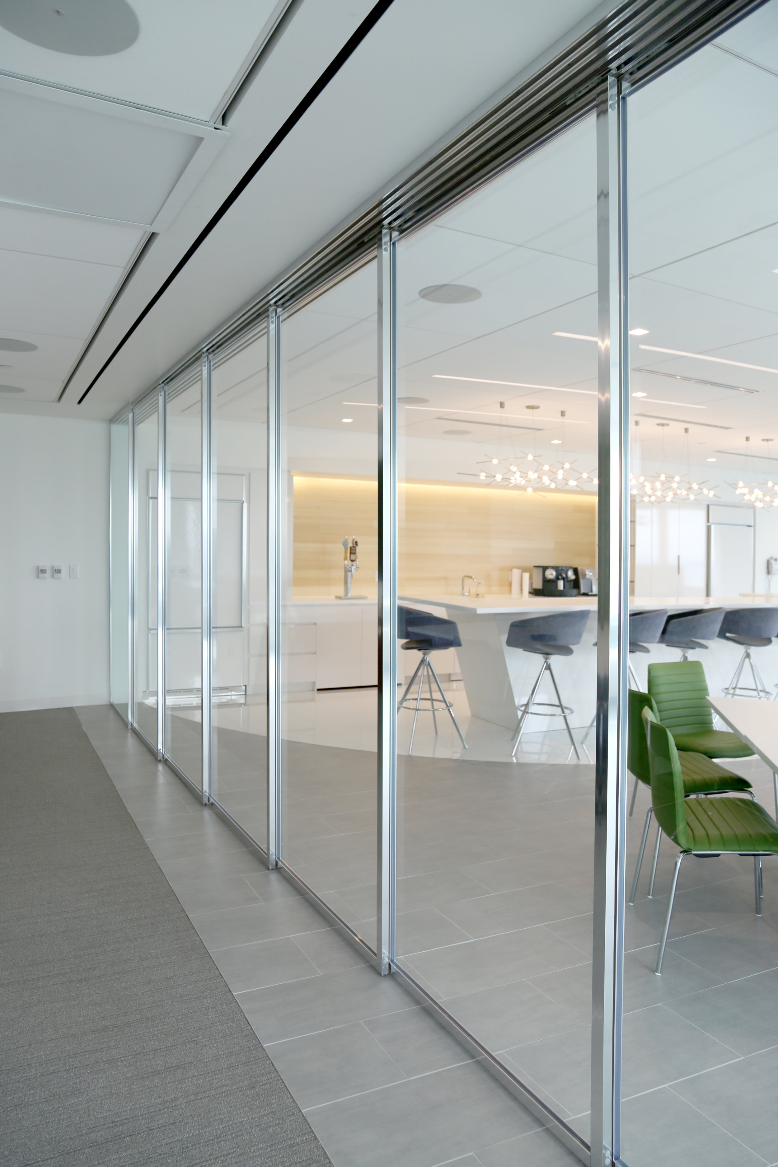 Sliding Glass Wall System with Aluminum-Framed Panels - Spaceworks AI.jpg