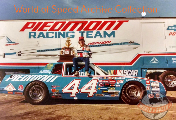 Terry Labonte on his Championship winning car with Championship trophy, 1996