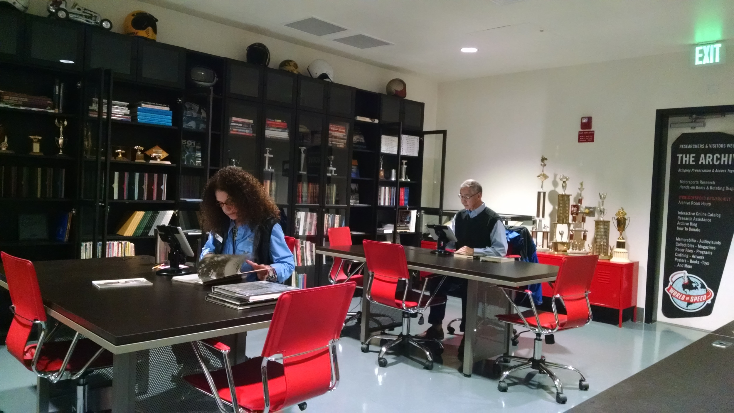 Volunteers process books to be included in our online catalog and available to visitors.