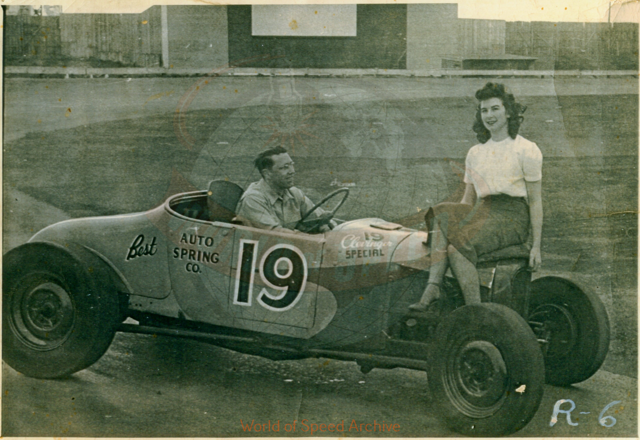 Hildick Photo Collection WOS#5072, BH001  Received submission:  Don Moore in Jack Greiner's '27 that he purchased from Dick Clevenger for $425.; 1948 Portland Speedway; model is Doris Mitchell