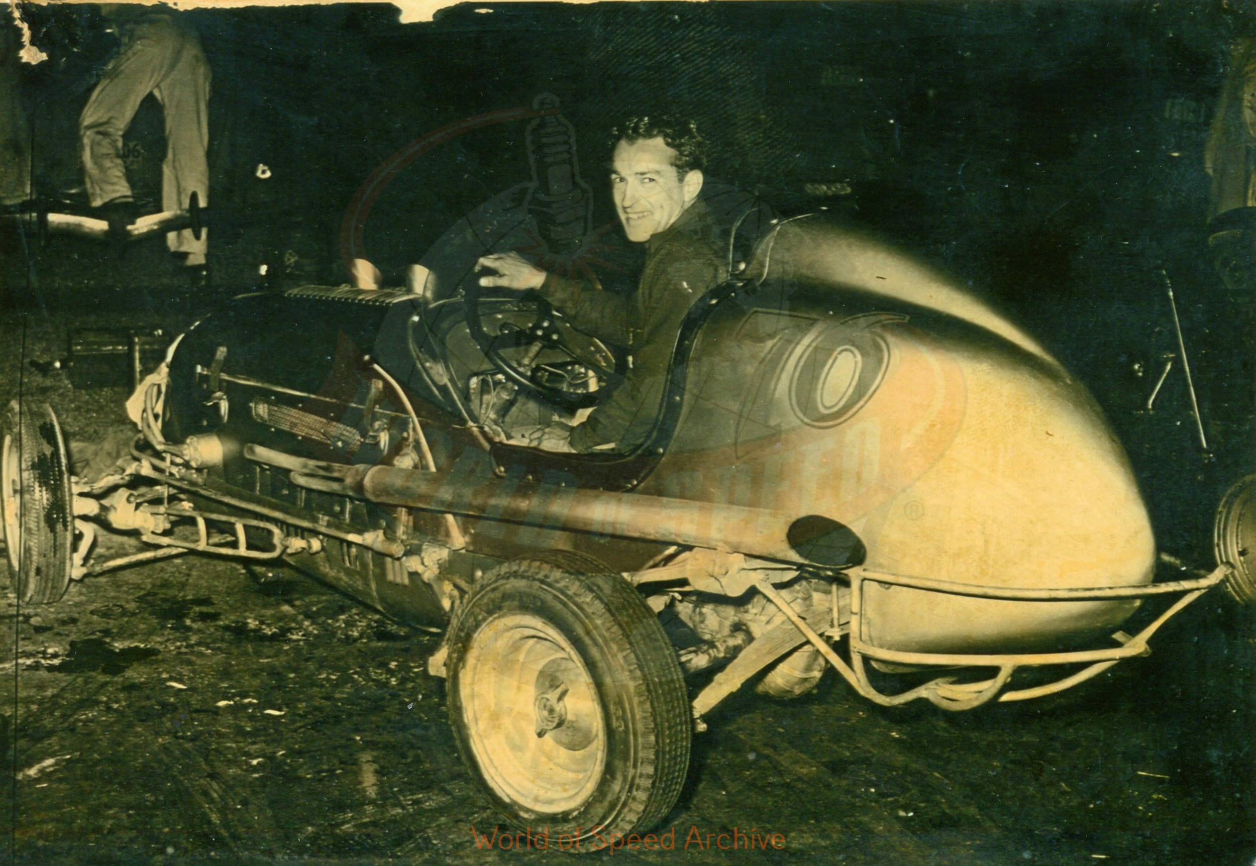 Hildick Photo Collection WOS#5072, BH003  Received submission:  This is Gordy Livingston and the car was owned by Col. Tex Roberts.