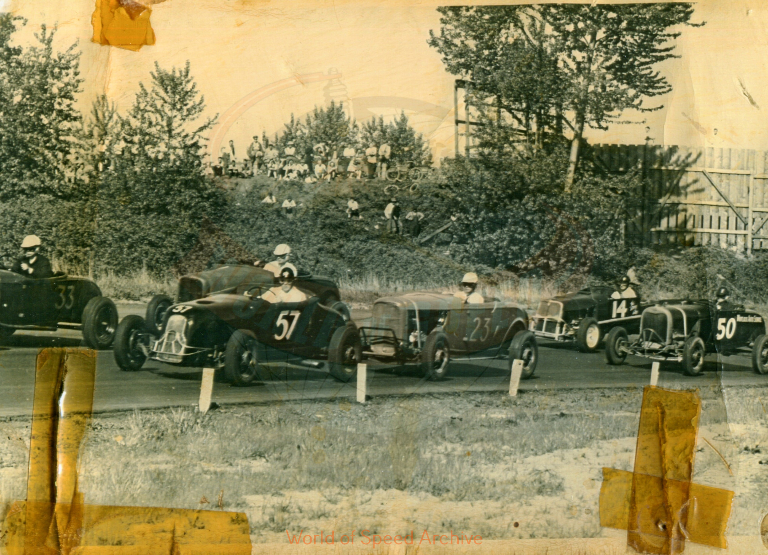 Hildick Photo Collection WOS#5072, BH007  Received submission: # 57 Don Moore in Al Reamer's car; #33 Jim Martin in Tom Storey's car; #23 Randy Francis in his own car; #1 Max Humm; #50 Dick Boubel #14 either Phil Foubert, Dick Martin, or Bob Gregg; Portland Speedway, probably 1946