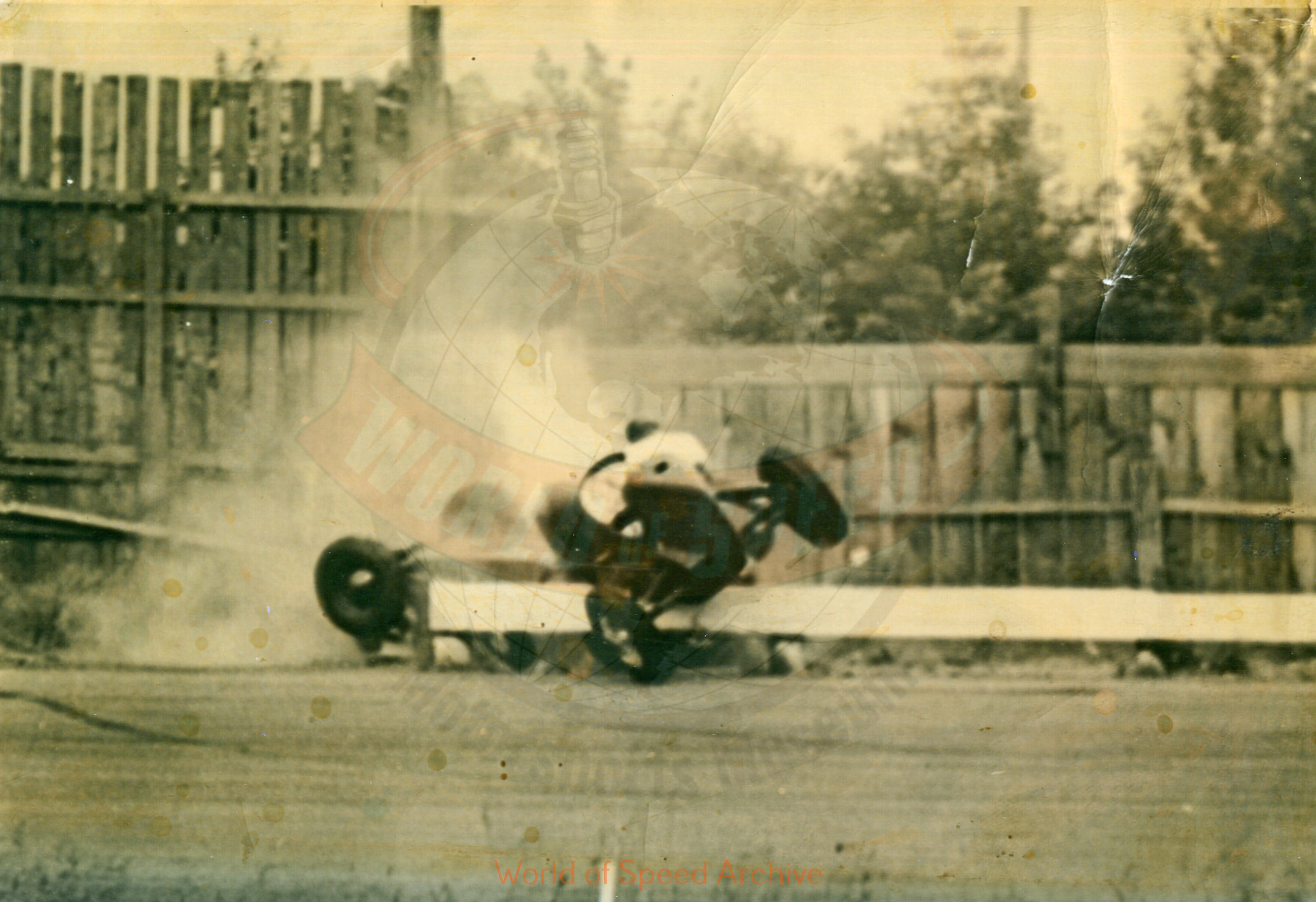 Hildick Photo Collection WOS#5072, BH018  Received submission:  1947 Portland Speedway; Gordy Youngstrom #46 (owned by Bob Scovell) on the rail, Marvin Cox #5 upside down; both survived uninjured