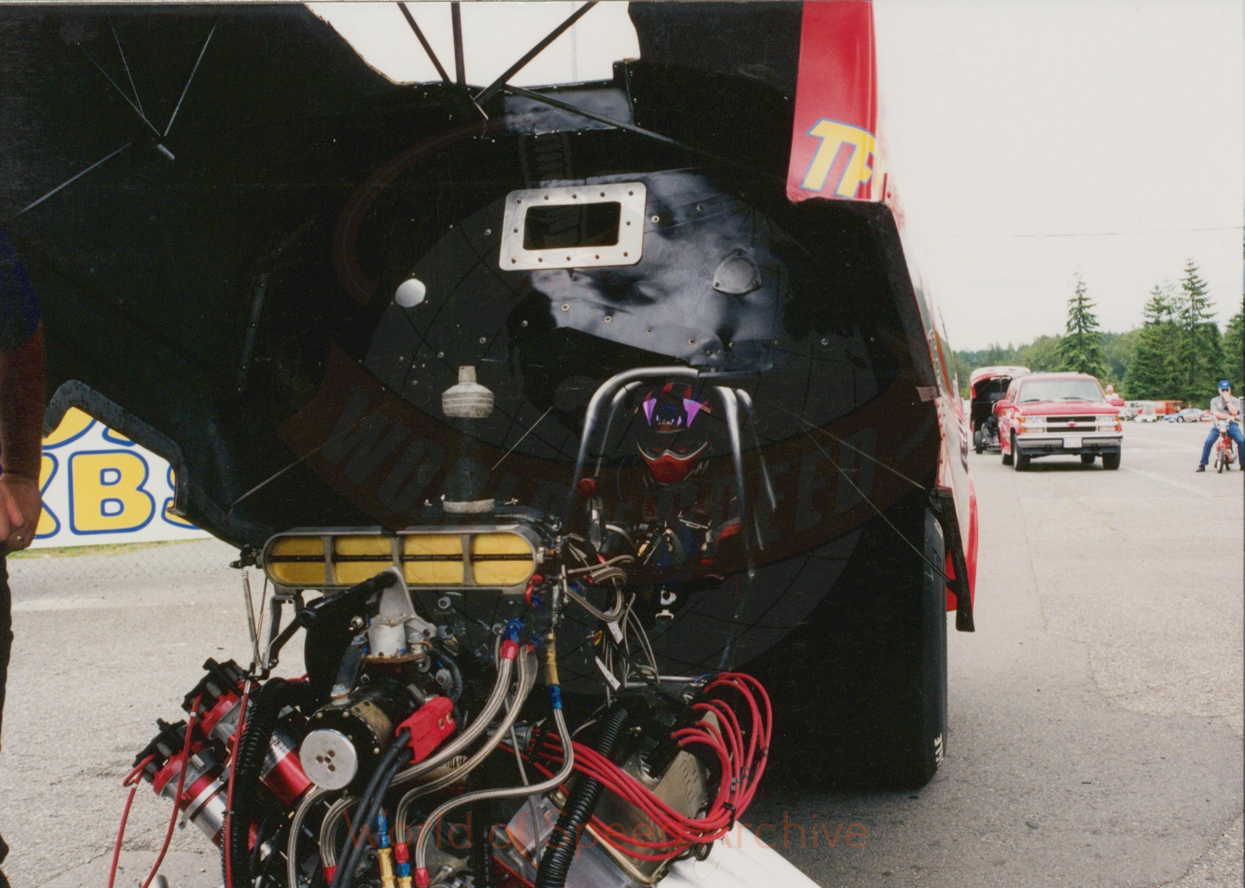B2-S2-G2-F3-001 - Funny Car open with view of engine and seated driver with helmet