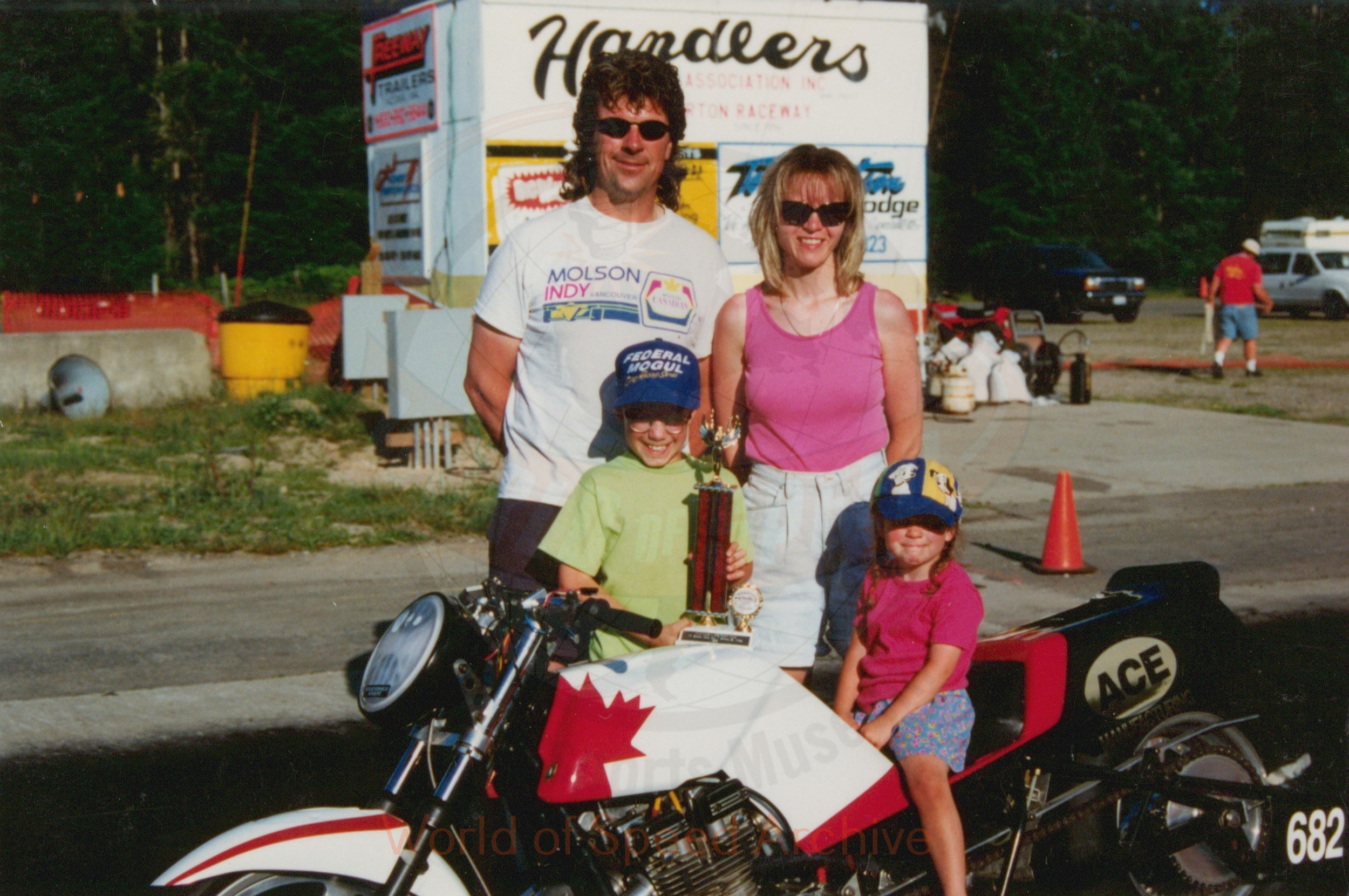 B7-S5-G3-F2-001 - trophy drag bike rider with family