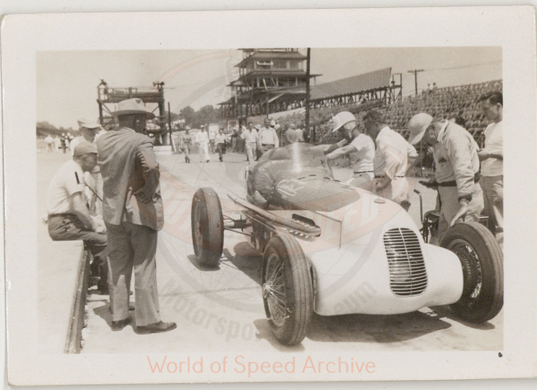 WOS#3786 - GM04 p046: Jimmy Martin stepping into car, Indianapolis Motor Speedway