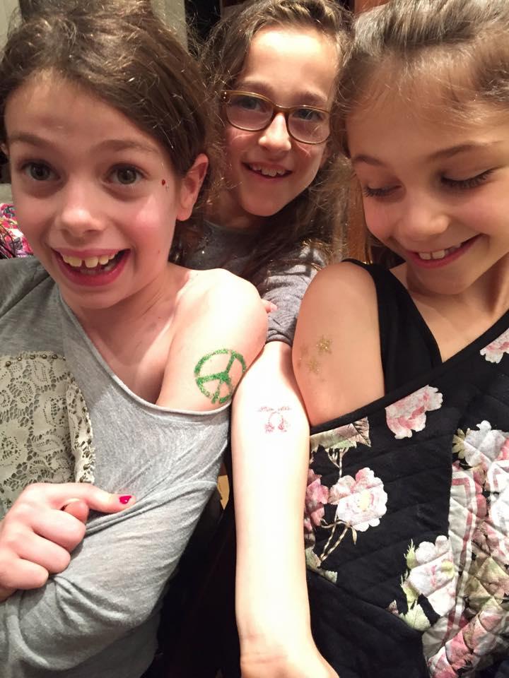 3 girls shoulder tats.jpg