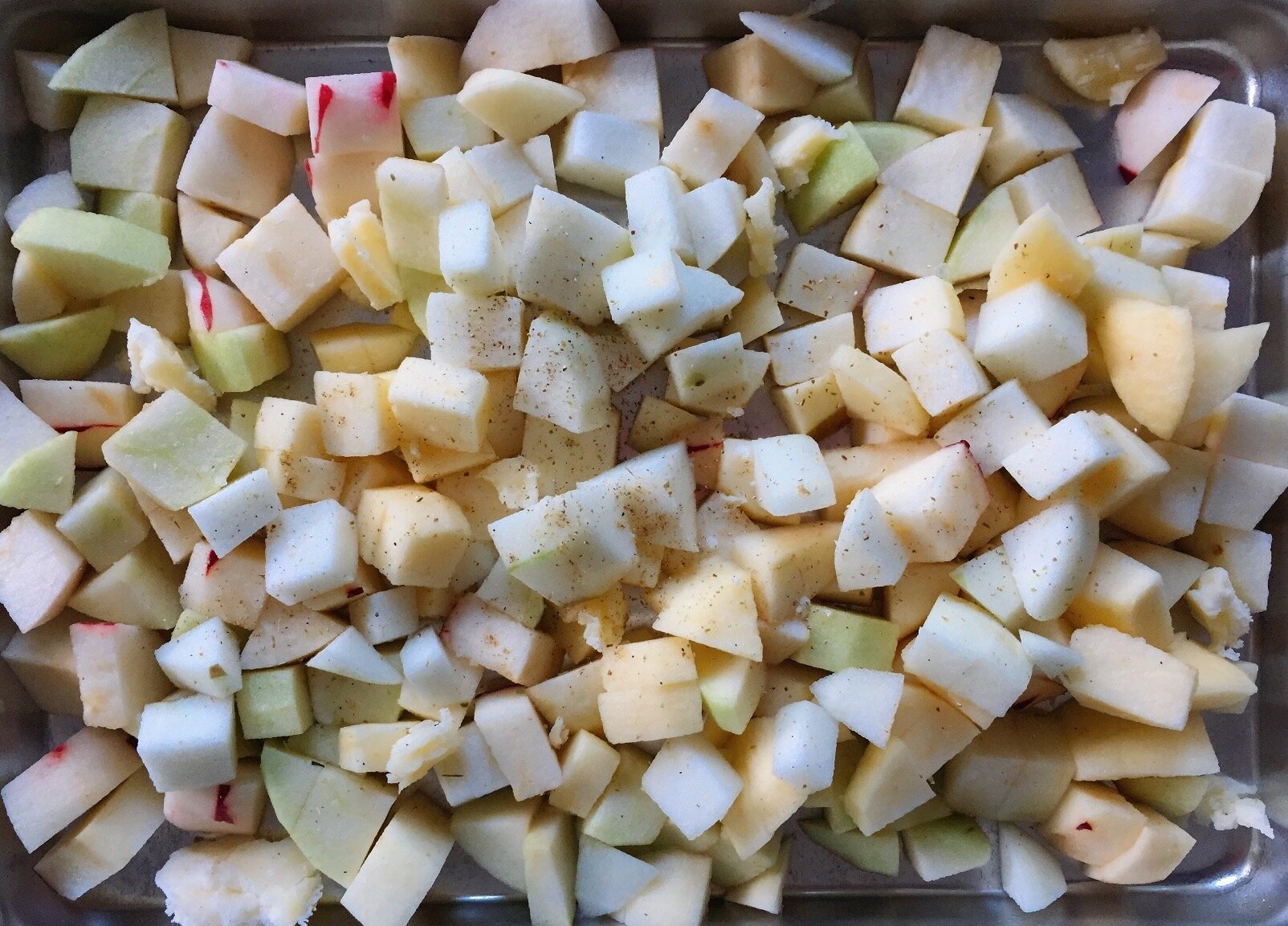 Chunks of apples with a little cardamom sprinkled on top.
