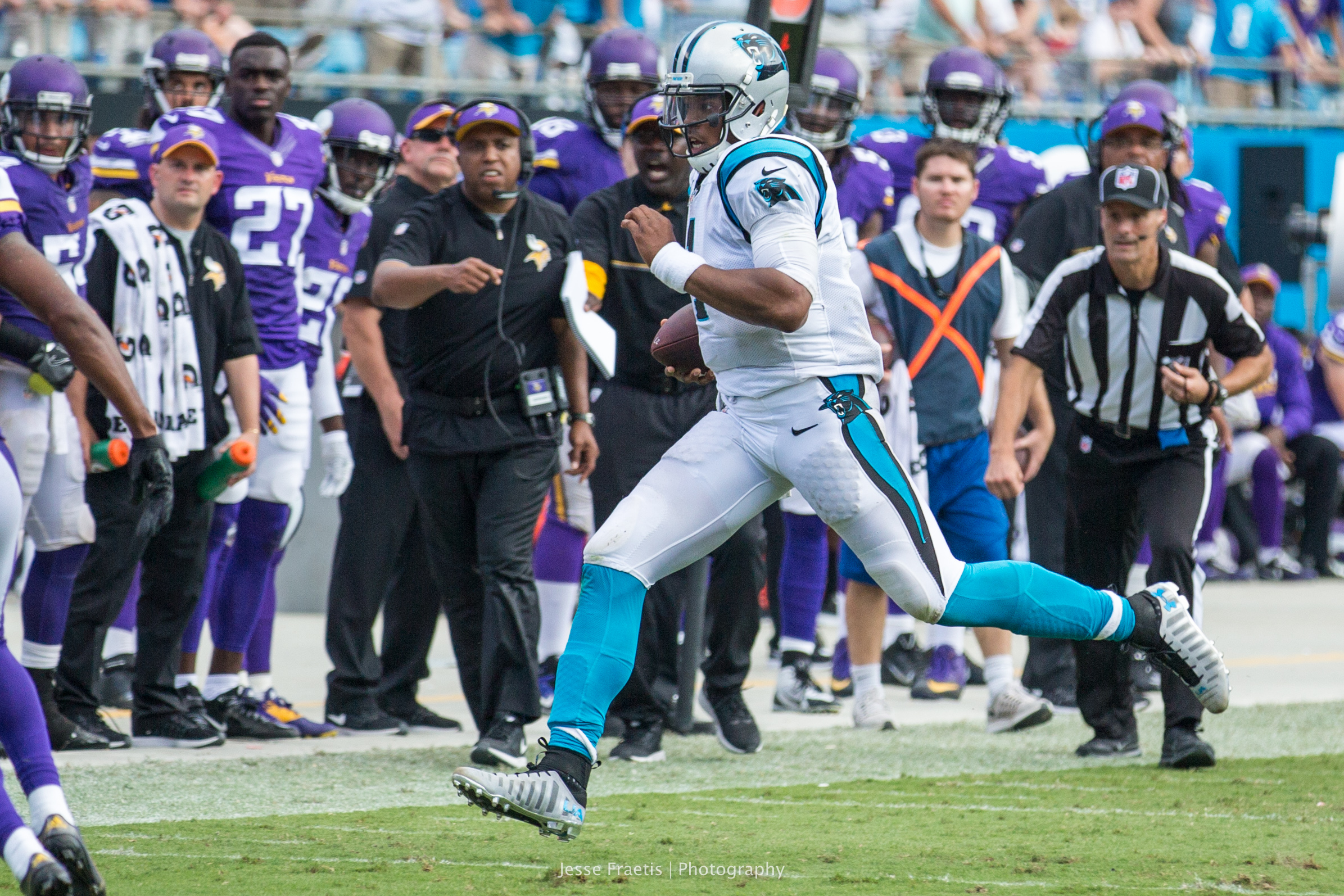 Cam Newton escaping what would have been yet another sack.