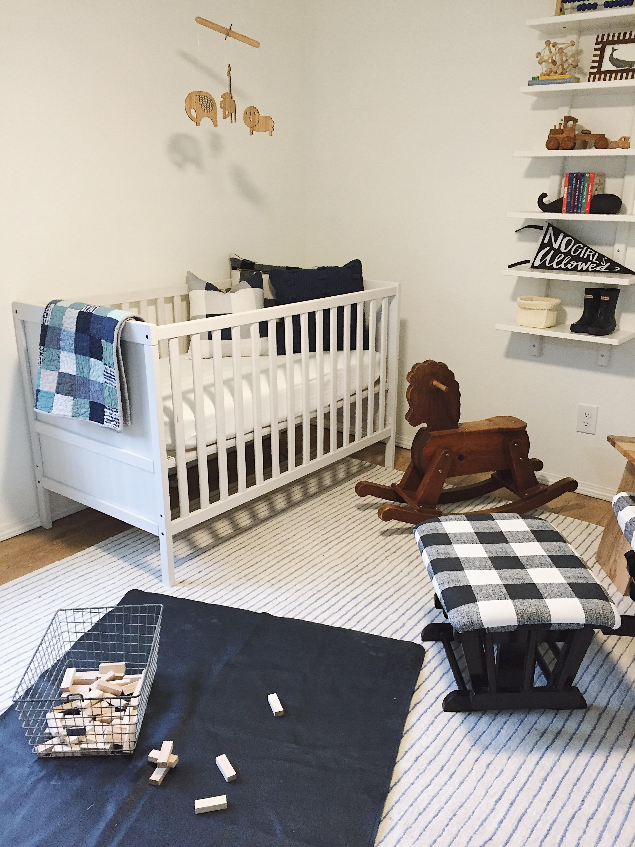 Gathre Mat ,  Rug (similar) ,  Crib (similar) , Light and Dwell Pillow,  Rocking Horse (similar) ,  Locker Bin ,  Shelf (similar)
