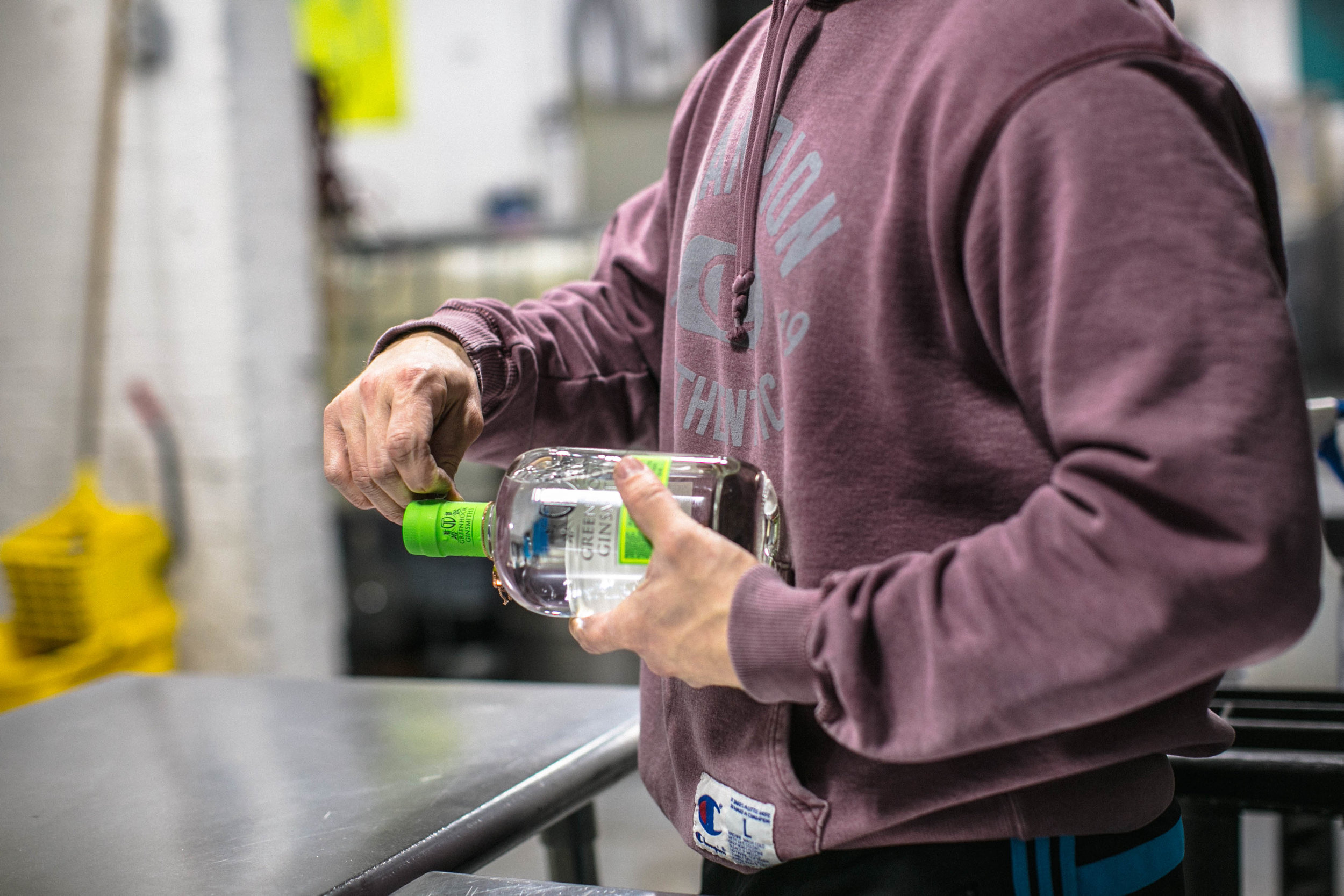Each hand-labeled bottle of Greenhook Gin undergoes a quality-control check before leaving the distillery.