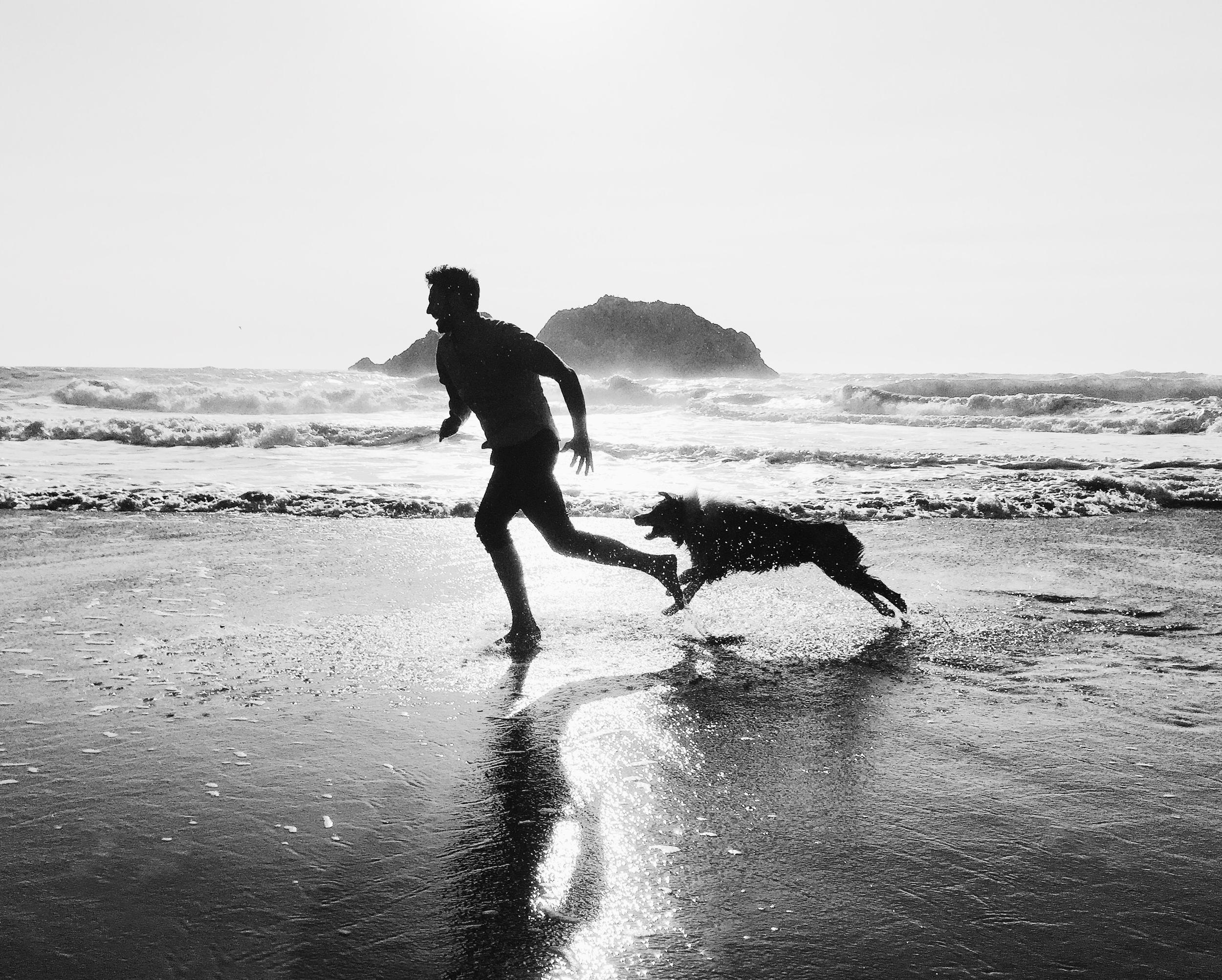 Preston and Preston running on beach San Francisco