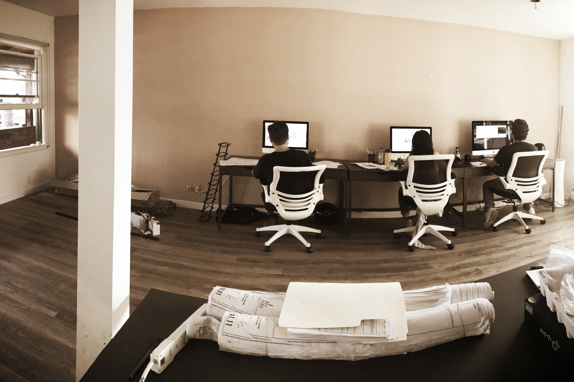 New floors installed. Throughout the remodel, designers working away.