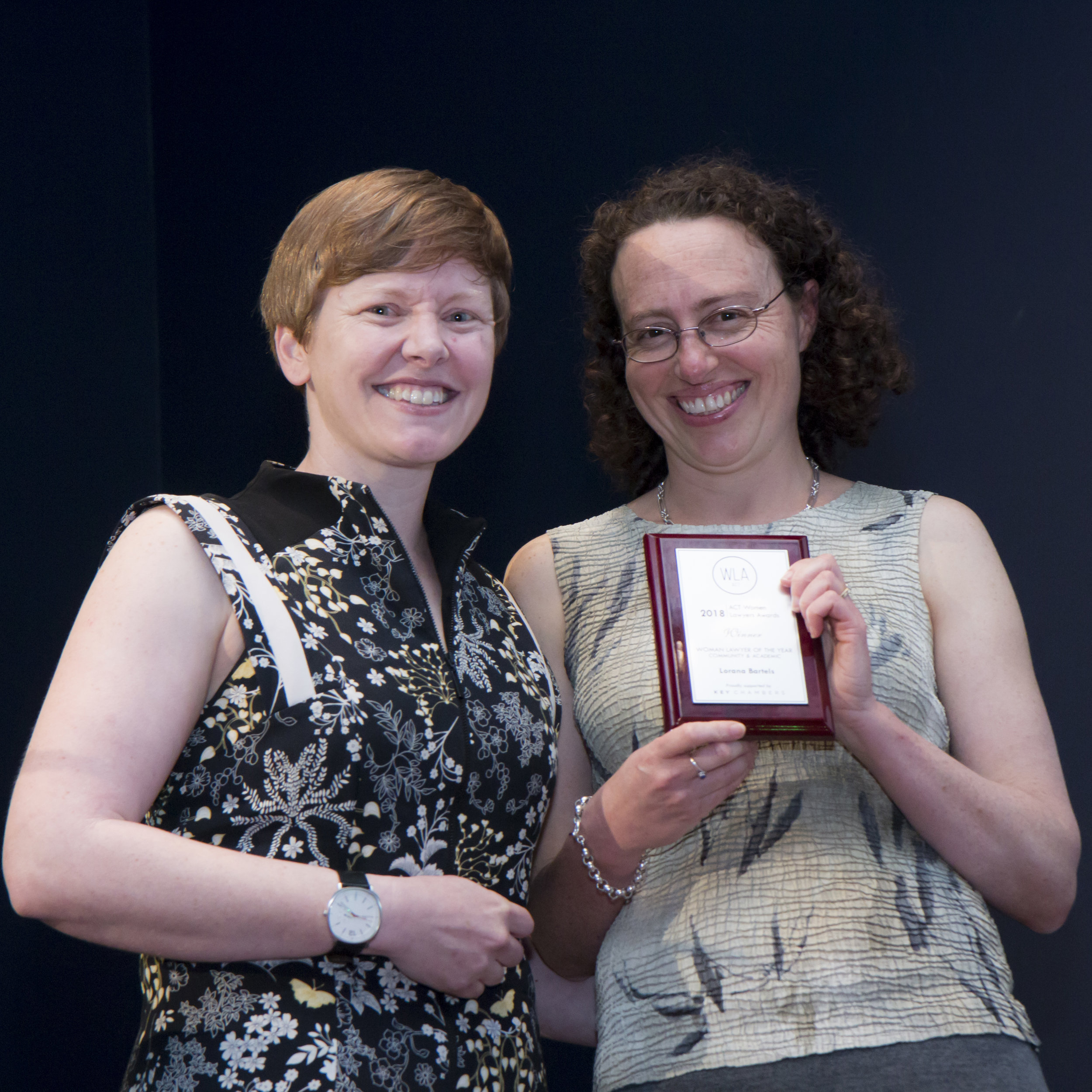 Professor Lorana Bartels receiving her award from Heidi Yates, ACT Victims of Crime Commissioner