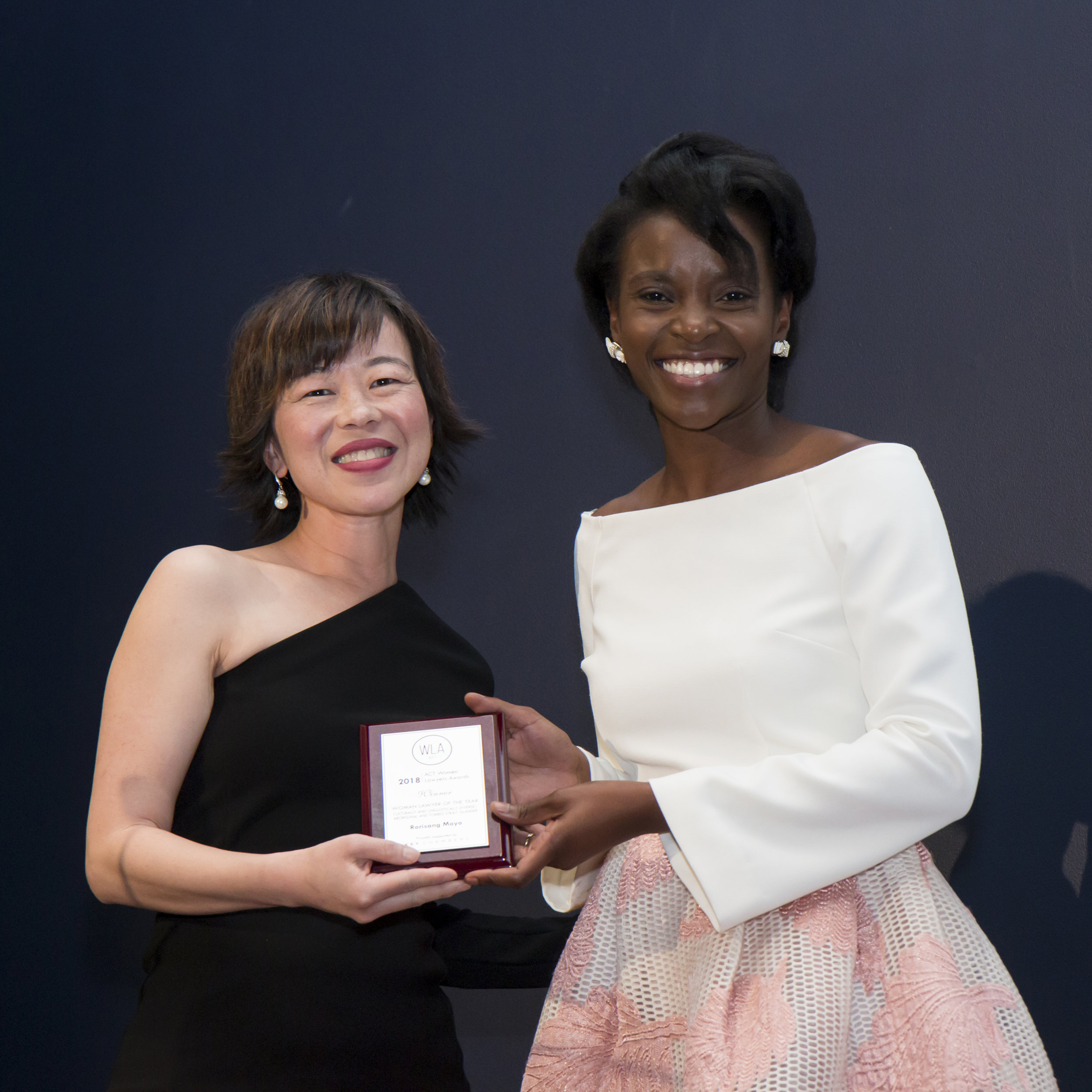 Rorisang Moyo receiving her award from Liz Huang Hughes-Brown, winner of the 2016 CALD or Aboriginal and Torres Strait Islander Woman Lawyer of the Year Award.