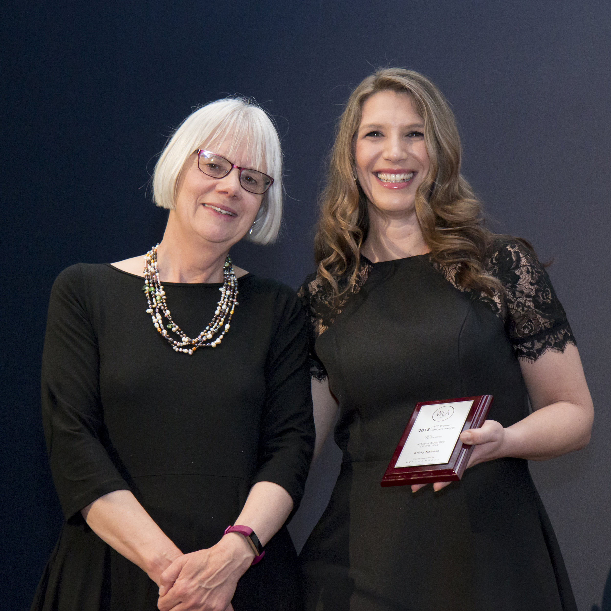 Kristy Katavic receiving her award from Justice Hilary Penfold
