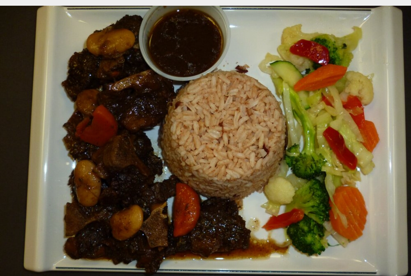 Oxtail with rice & peas