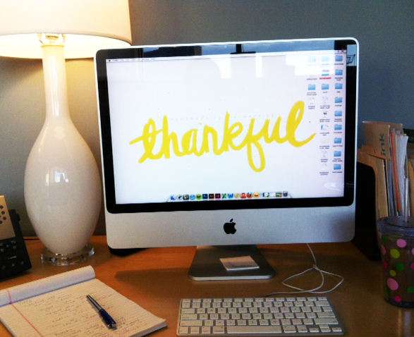 Lovin' my cute desk and my   November wallpaper  . It is an accurate description of how I feel about my new job.