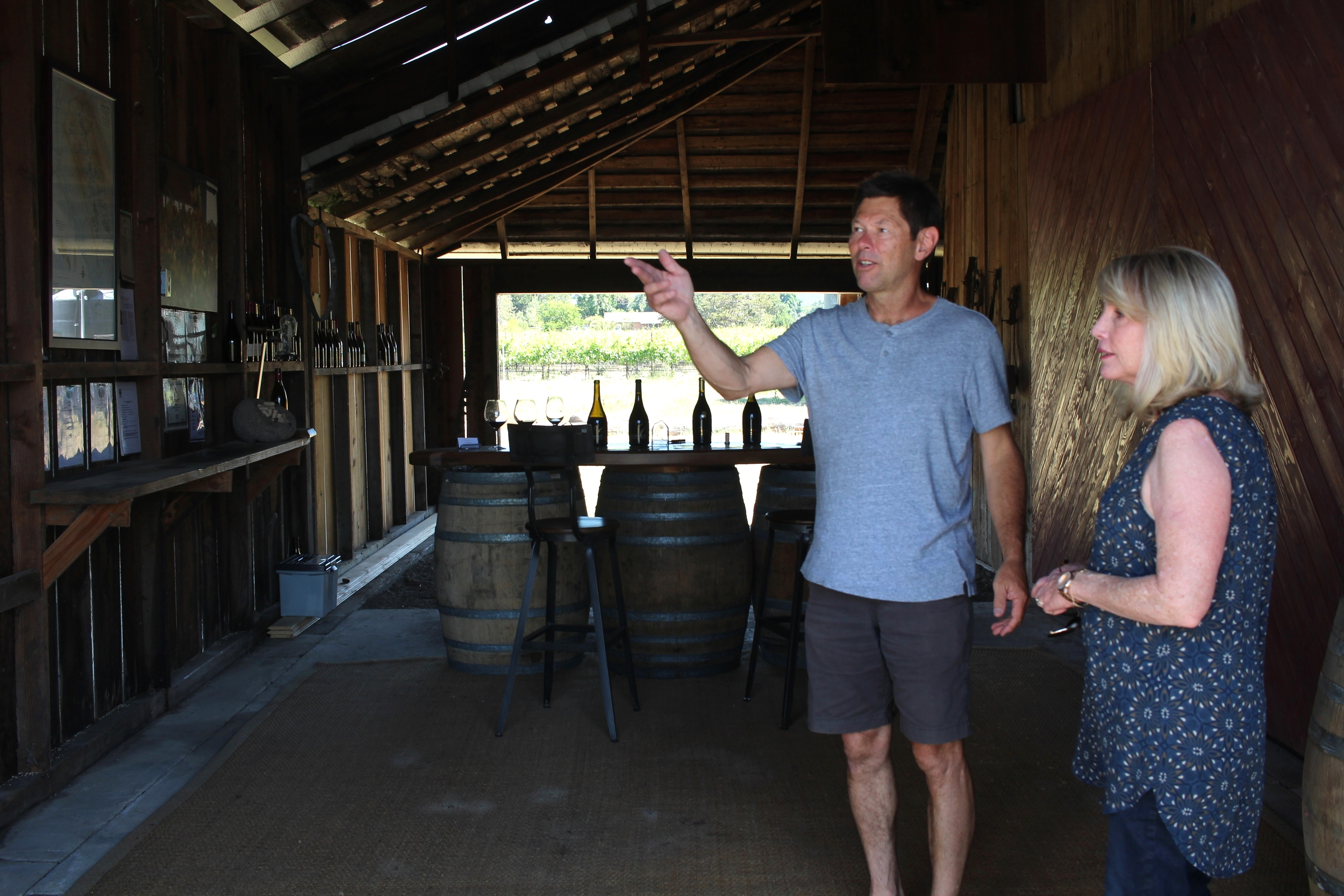 Bill Canihan waves us into the barn.  Yes, this is where you taste!