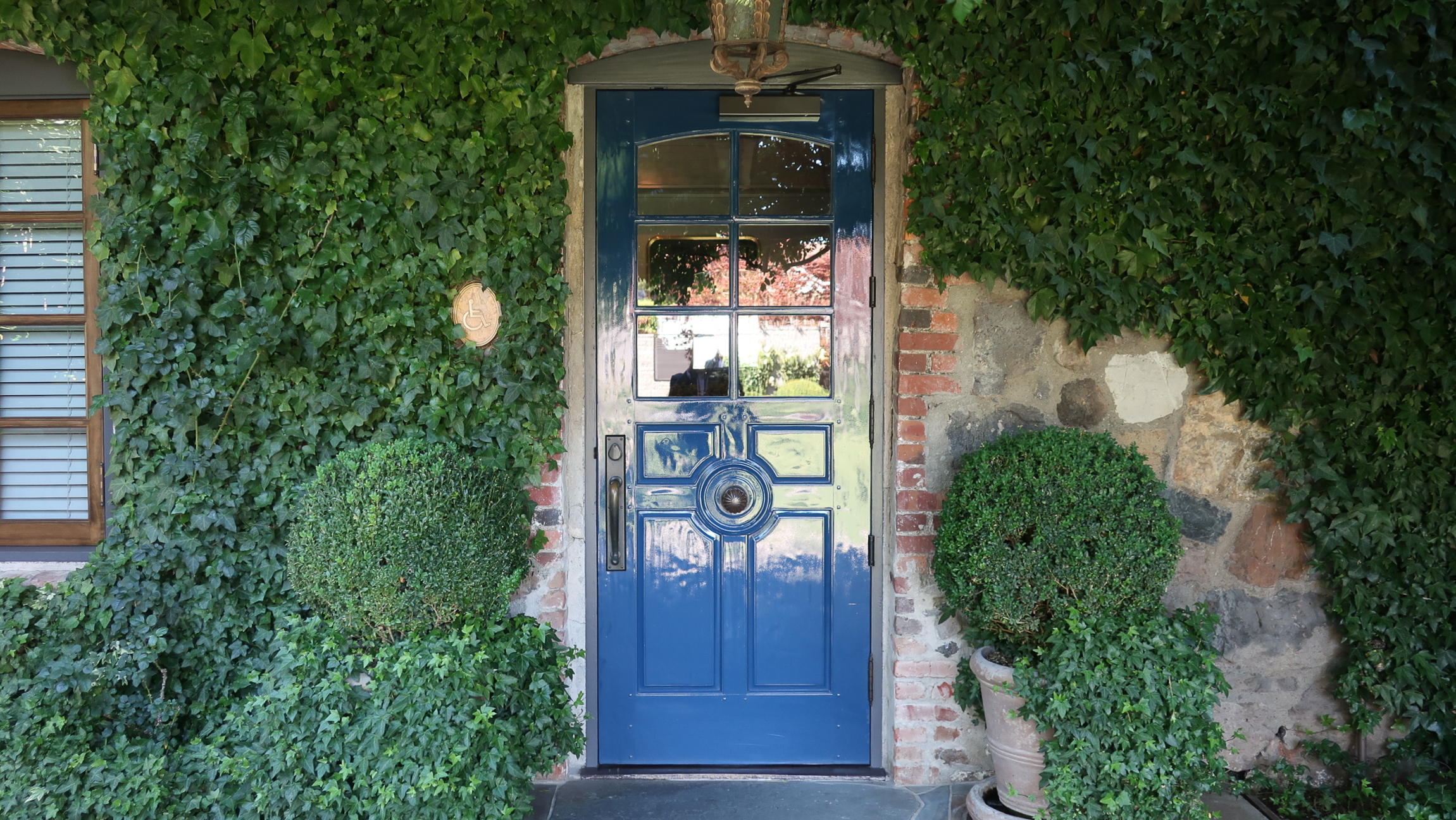 The famous Blue Door welcomes you to The French Laundry