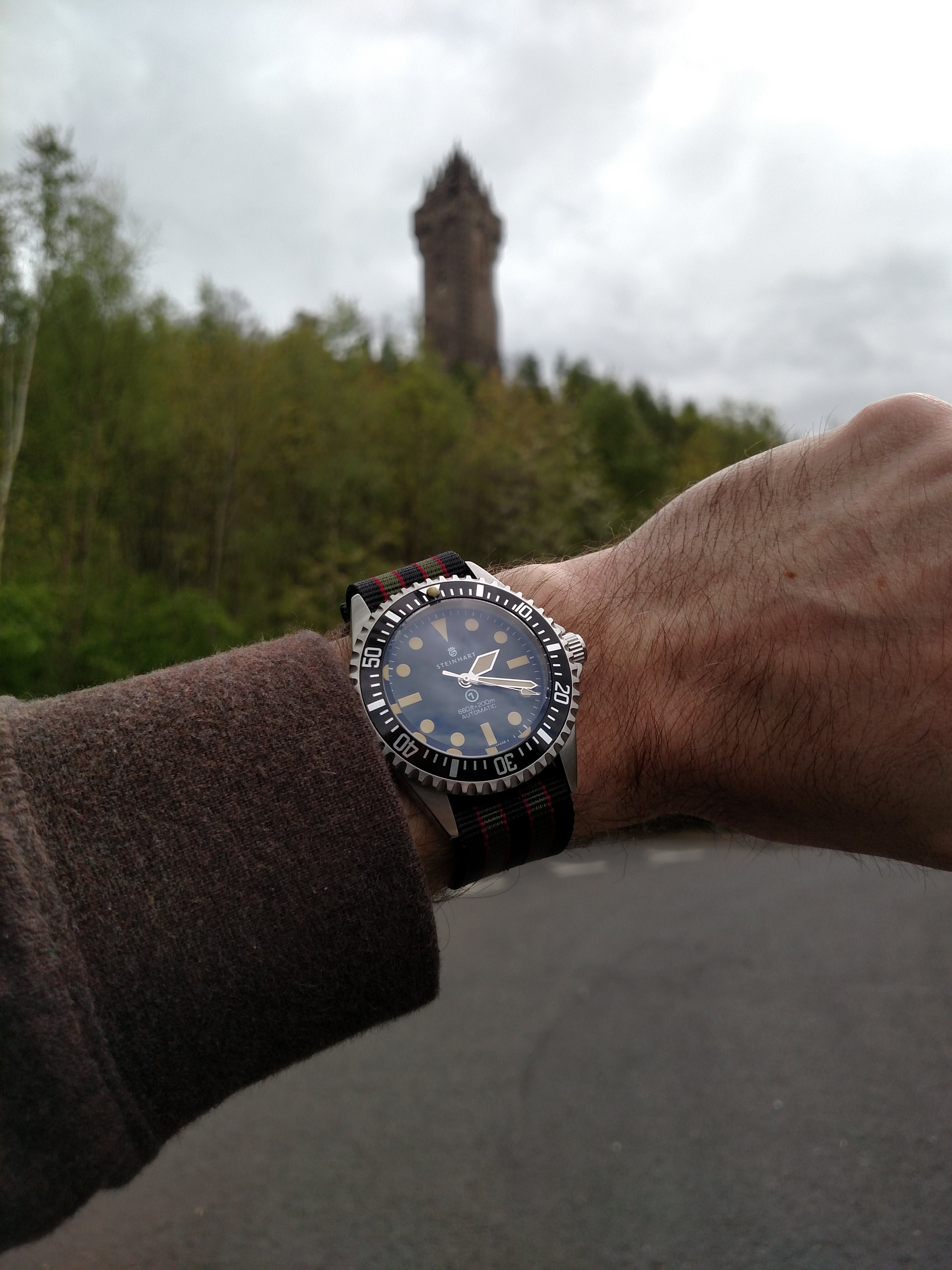 Steinhart Ocean Vintage Military (Rolex 5517 homage) beneath the William Wallace National Monument  Abbey Craig, Stirling, Scotland