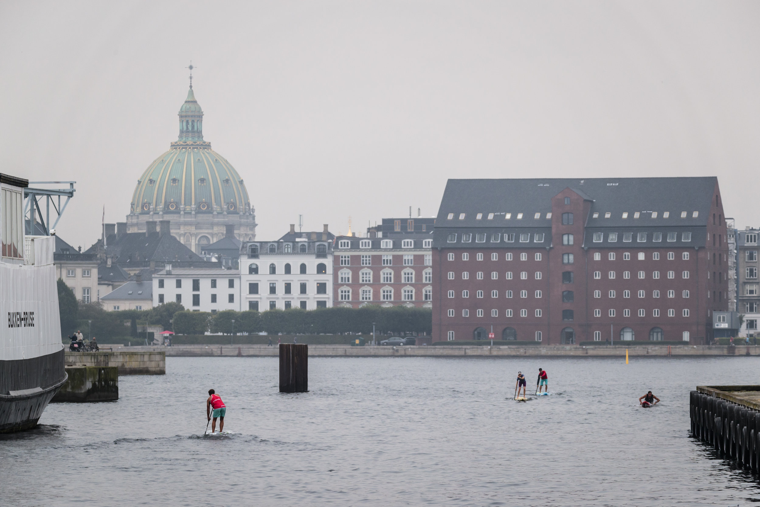 SUP and Paddleboard Racers warm up in Copenhagen Harbor for the Distance and Sprint Races to come on Saturday and Sunday. Photo: ISA / Ben Reed