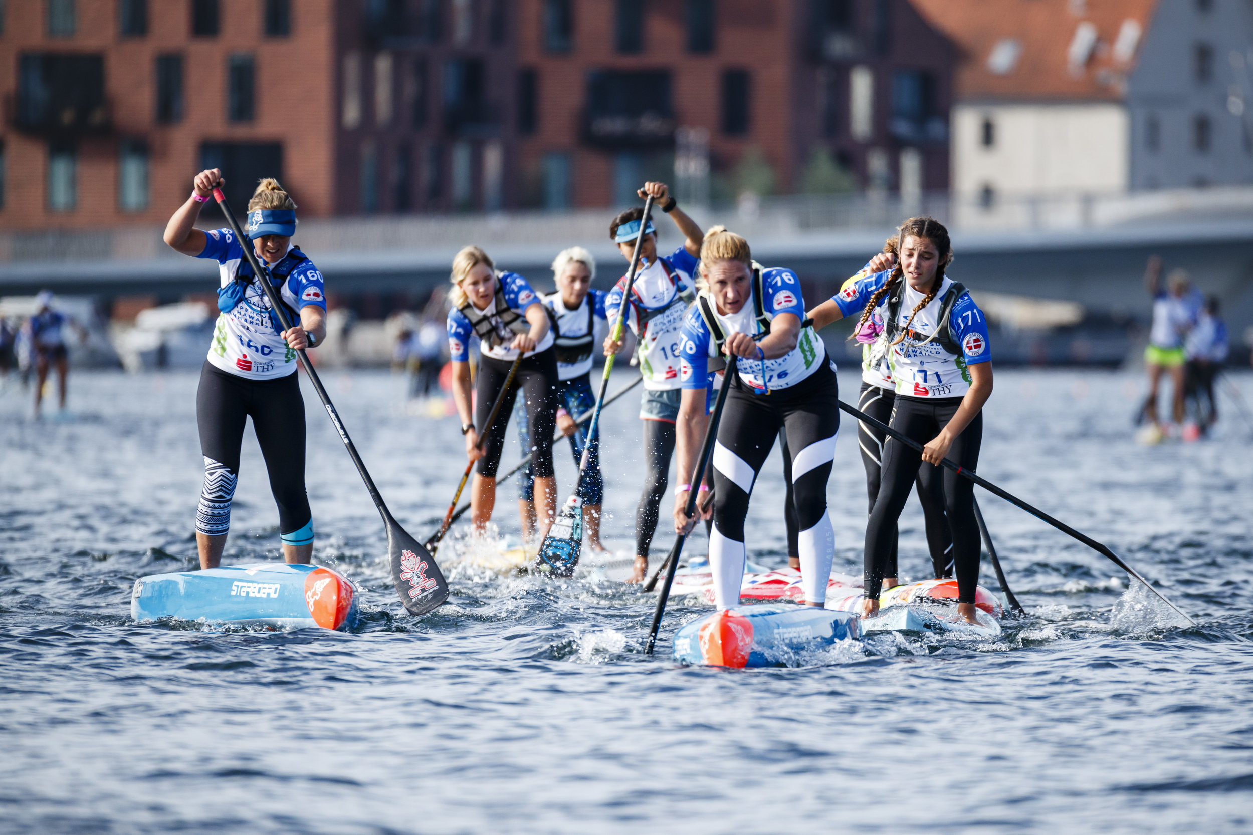 Distance Race - Distance Race is the marathon distance of elite SUP. Women and men compete in separate races. In Denmark, the route will start at the Opera House across from Amalienborg (the Queen's Palace). From there, the athletes paddle to the Little Mermaid, where they turn and paddle back. Four rounds or 20 km in total will be completed.