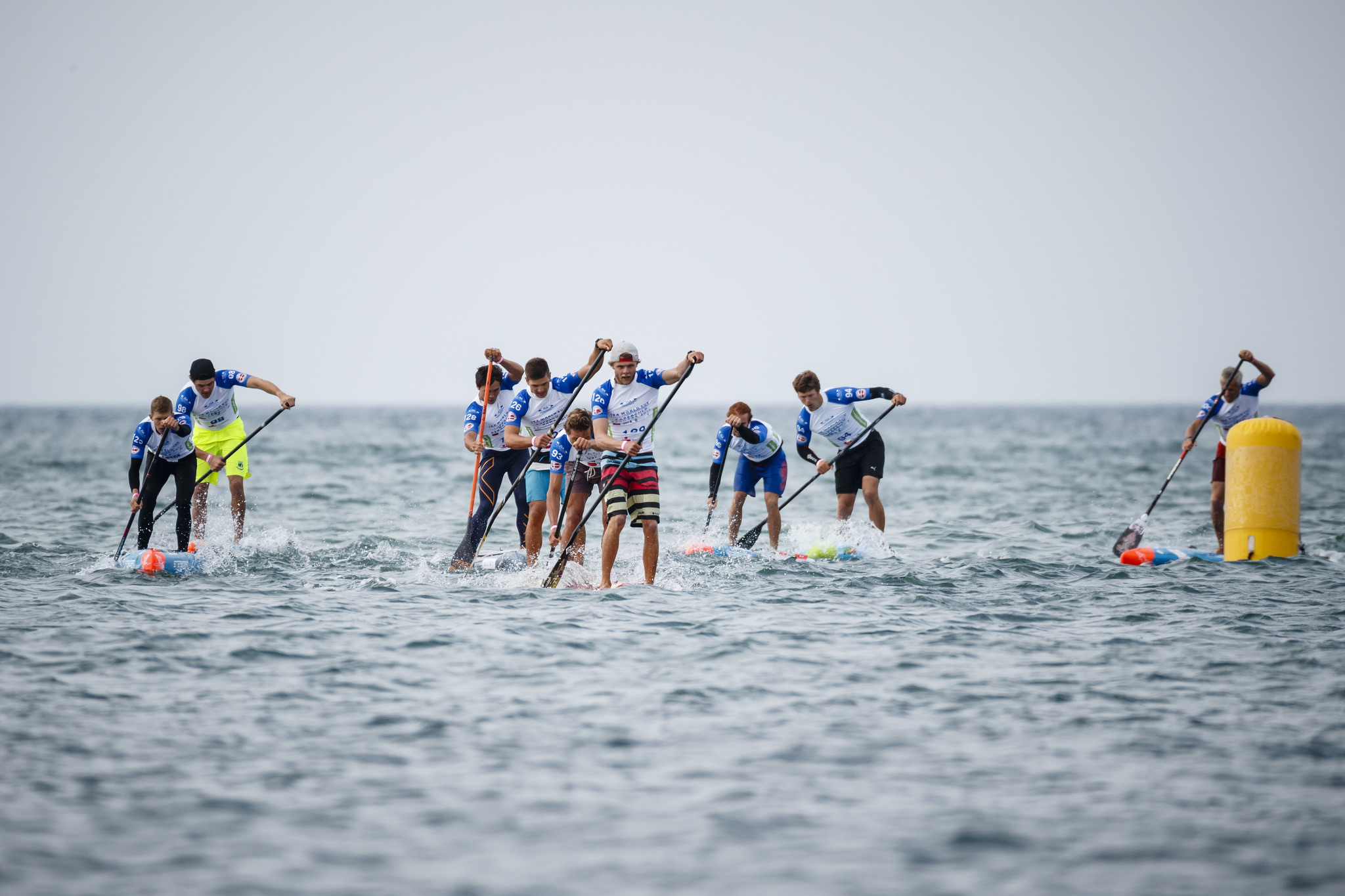 Technical Race - The Technical Race is also called surf-slalom. Typically, the competitors start on the beach (beach start). From here, carrying the board and paddle in their hands,they race to the shore, where they jump on board and paddle out through the surf. The race takes place on an m-shaped course marked with buoys, through which the athletes paddle several times. The athletes end up on the beach, where they run up the beach to cross the finish line. The technical race is an elimination race. The best end up in the final.