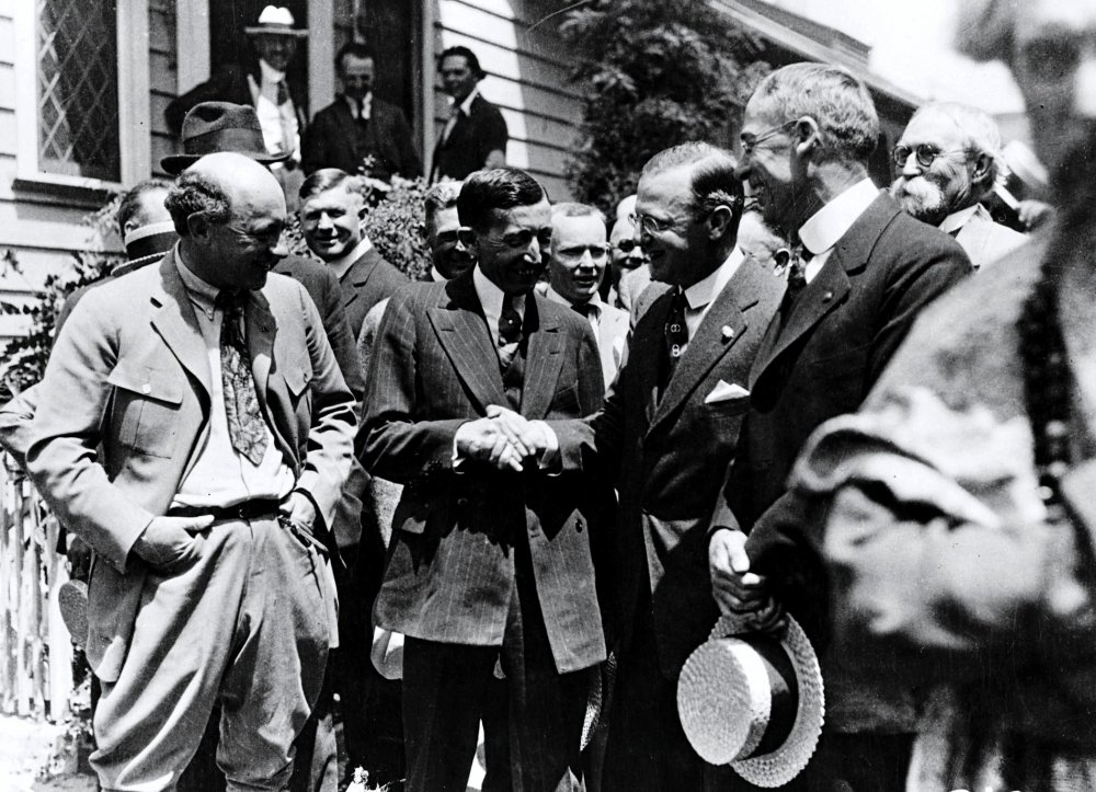 William Hays (center) shaking hands, c. 1920's