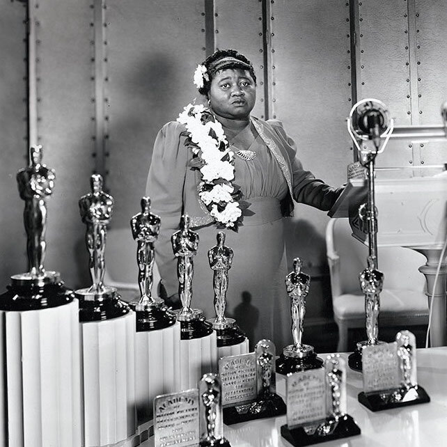 In 1940 Hattie McDaniel became the first black performer to be nominated for and win an Oscar, for her role in  Gone with the Wind .