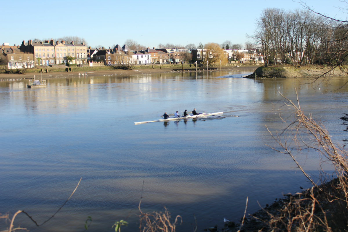 Rowing upstream on the Thames. The childhood home is on the opposite side, just behind the island.