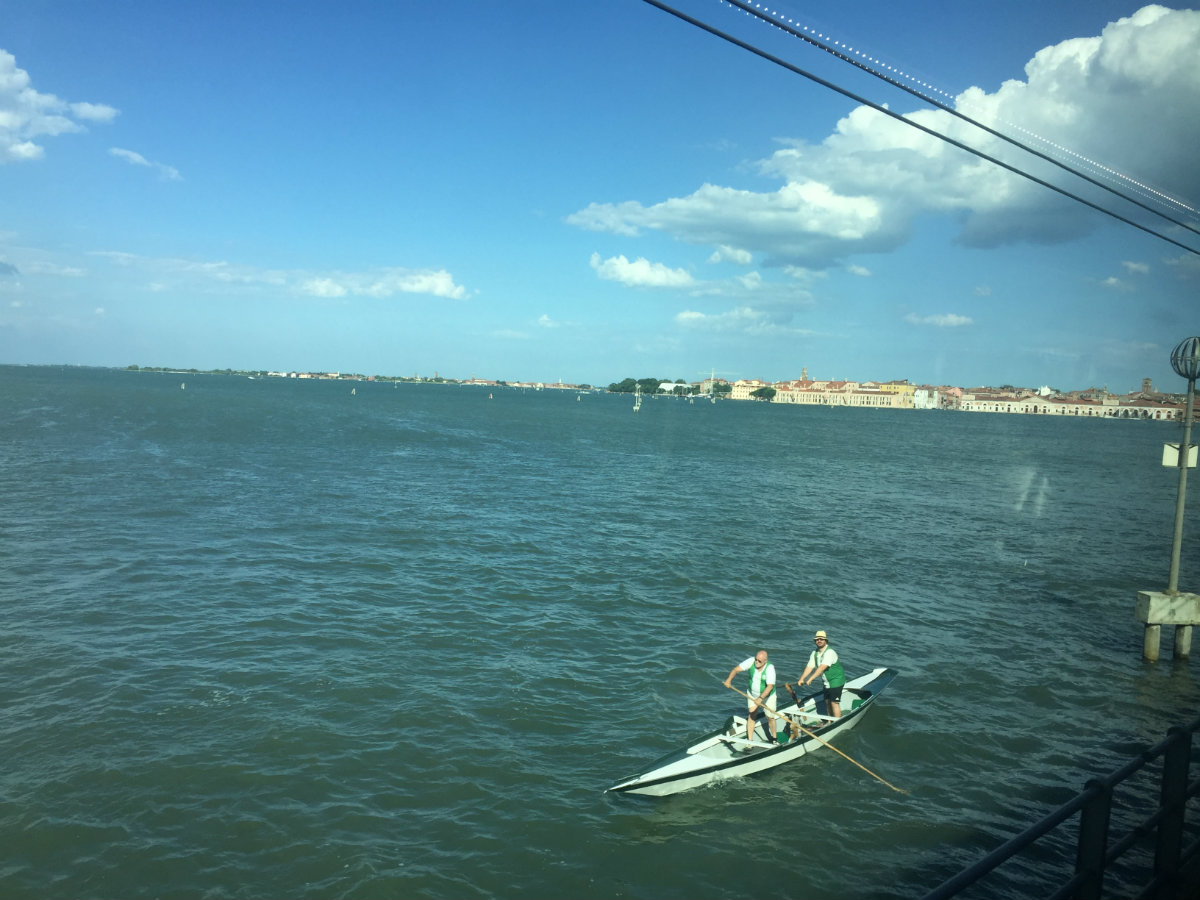 Crossing the Ponte della Libertàinto Venice. The gondoliers are practising for the race on the upcoming weekend.