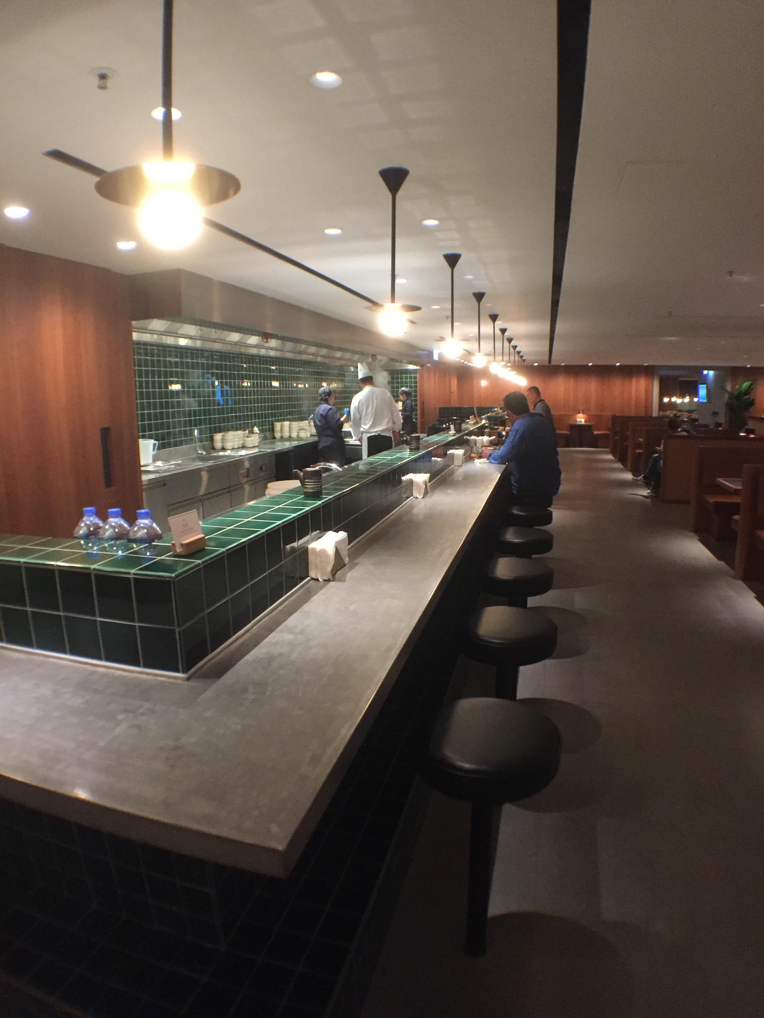 The Noodle Bar. I'll have the steamed pork bun, please.