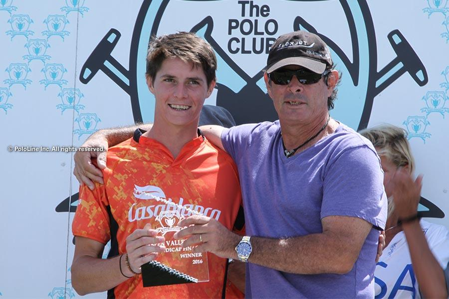 Juan Bollini awards his son Juancito. Photo from PoloLine Gallery