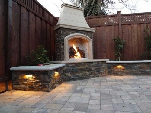 Stone walls incorporating a fireplace at findoo.net on Pinterest.