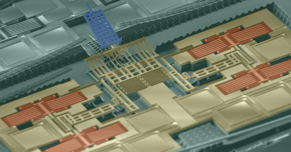 SEM image of a single-chip AFM. The suspended structures are made of the metal, oxide, and polysilicon layers of the CMOS process.