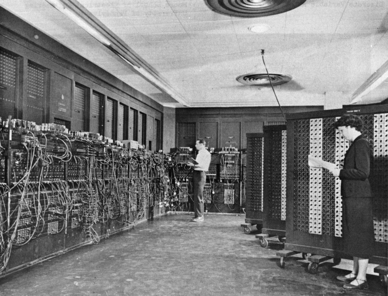 One of the first computers, ENIAC, in 1945. (Yes, it took up the whole room!)