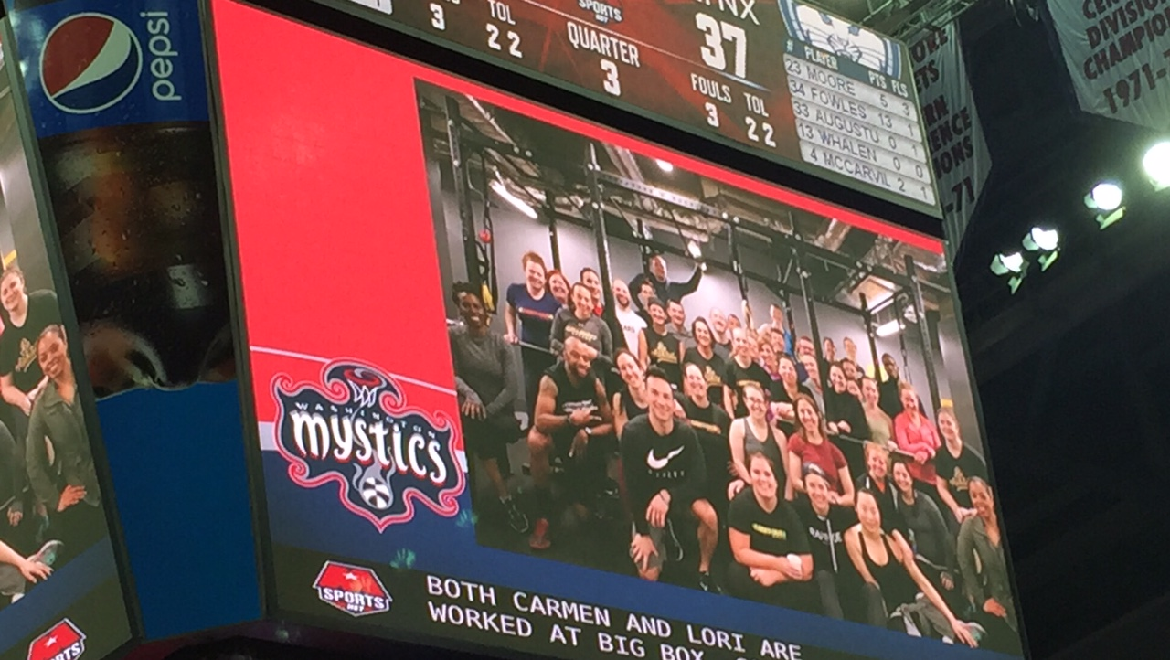 #bettertogether /Fit Fam on the jumbotron.