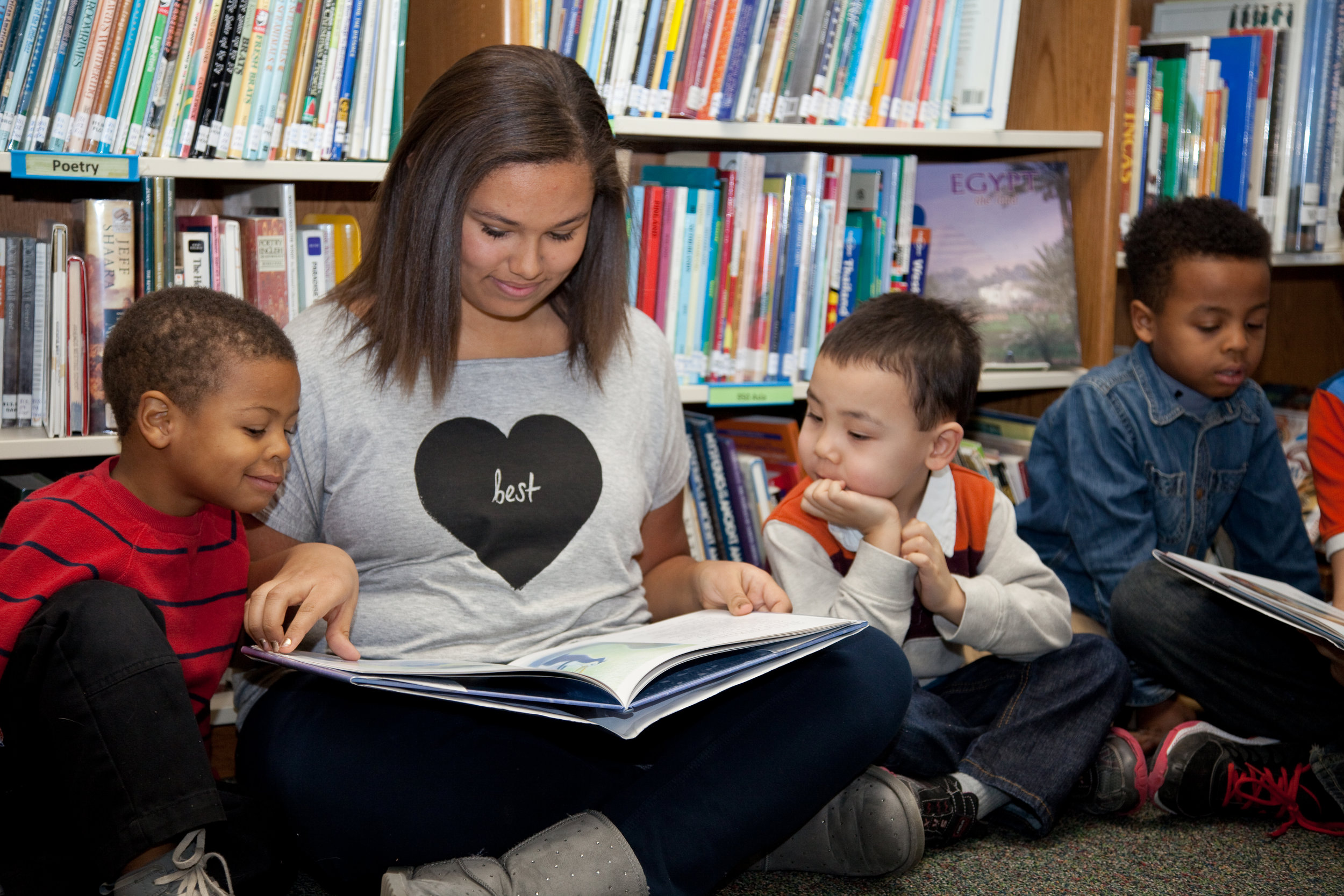 The Reading Buddies program builds confidence in Middle Schoolers, and gives our youngest students friends to look up to.