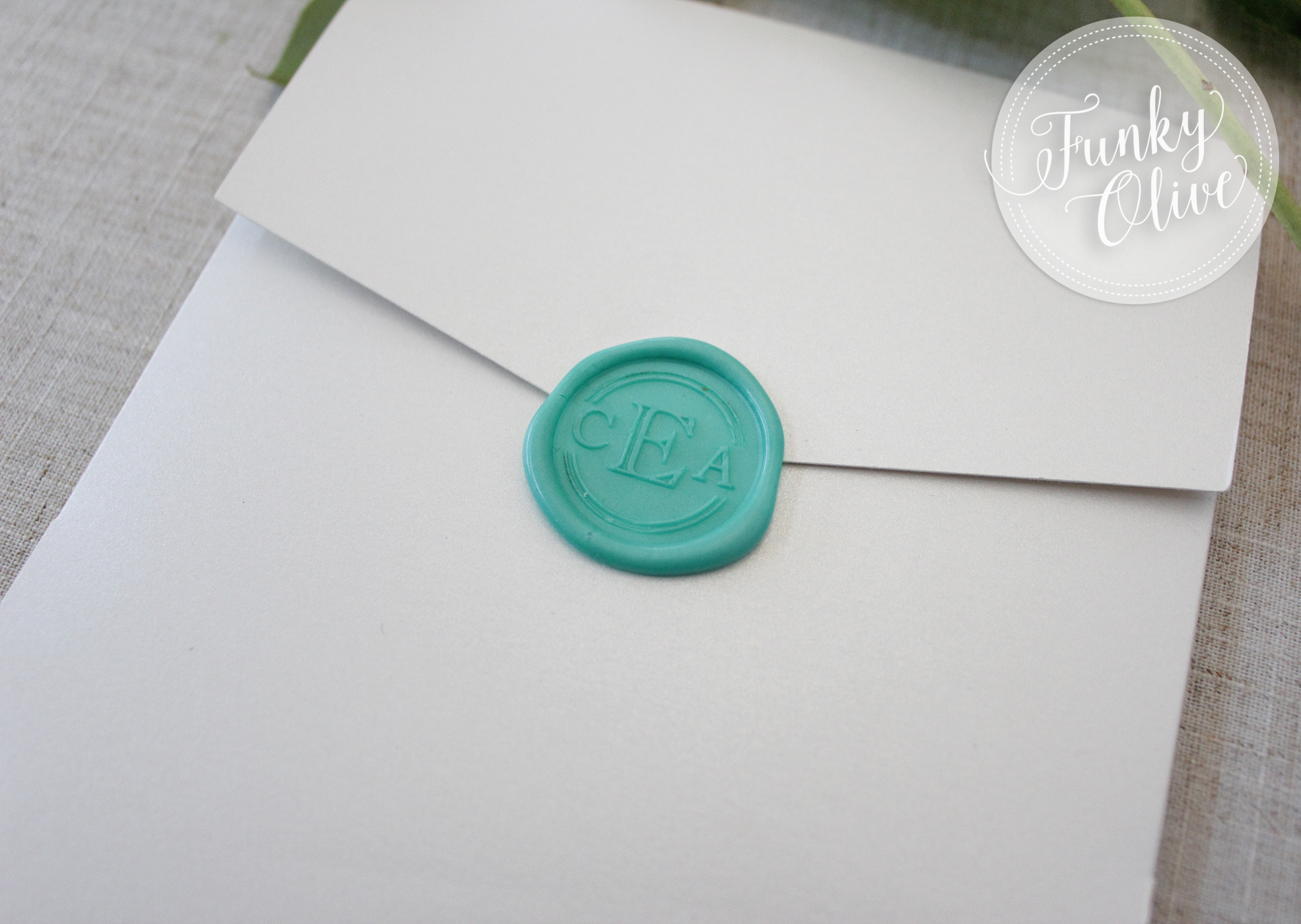 Their custom monogram was used on self-adhesive wax seals, so that the invitations weren't damaged when opened. photo © Funky Olive Invitations + Stationery 2017